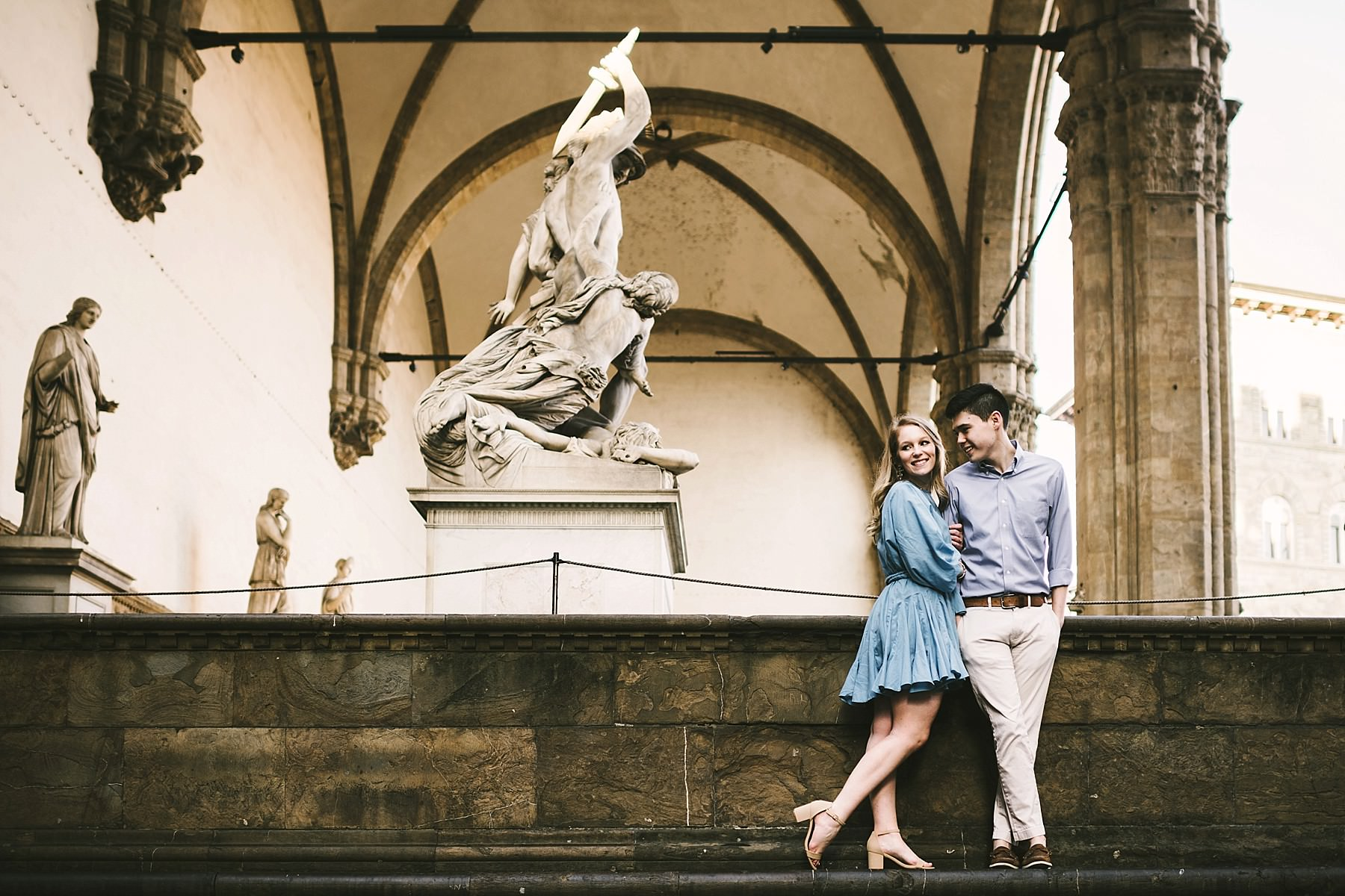 Never too young for romantic vacation photos in Florence. Early morning sunrise engagement photo shoot Piazza della Signoria