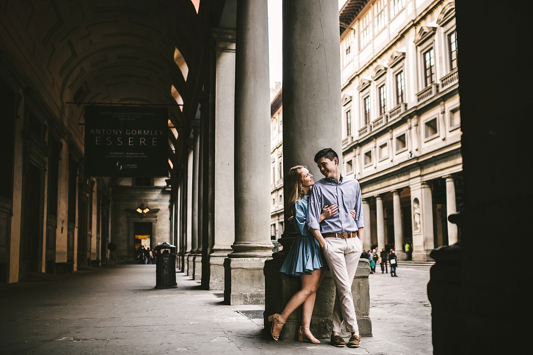 Romantic couple portrait in Uffizi Gallery Museum in Florence during sunrise