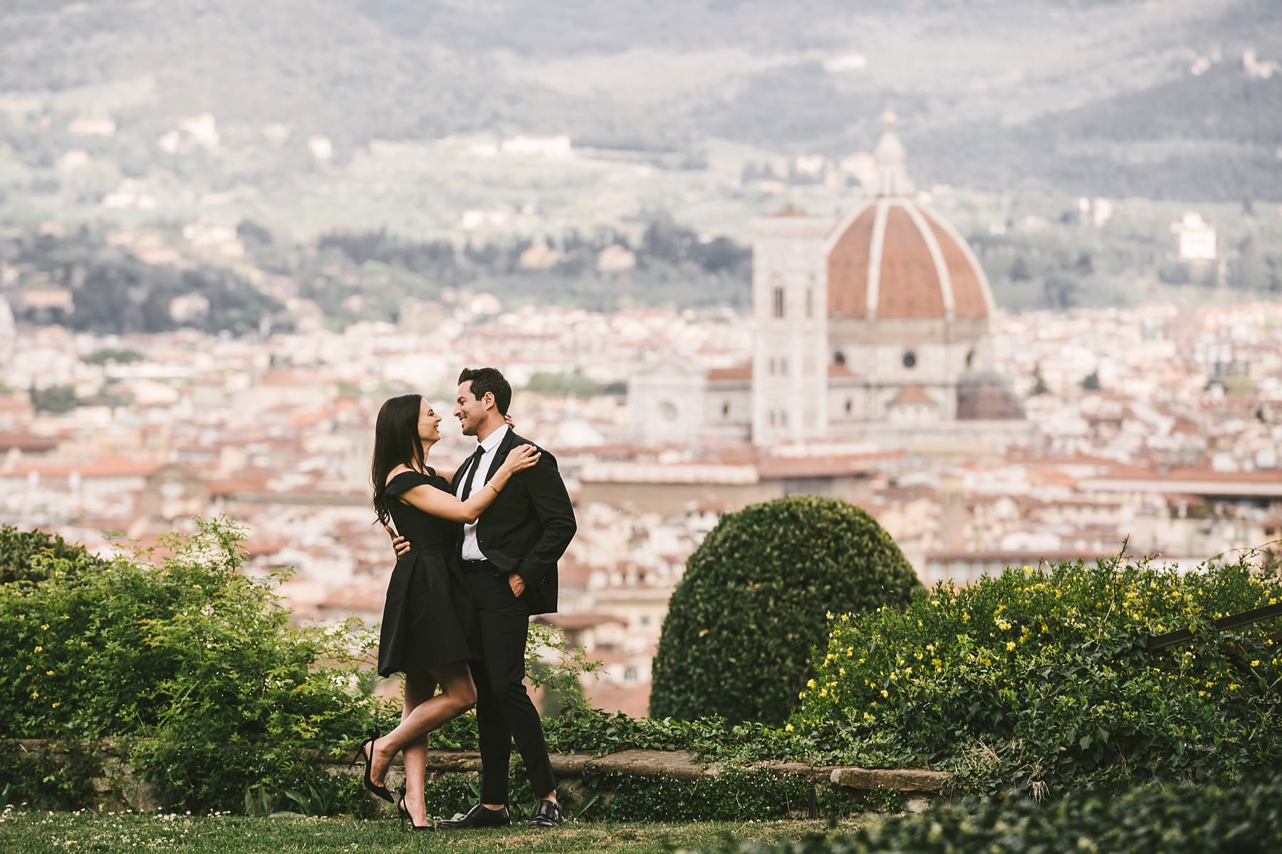 Couple portrait engagement pre-wedding photo session at Torre Bellosguardo with the Florentine Dome in the background