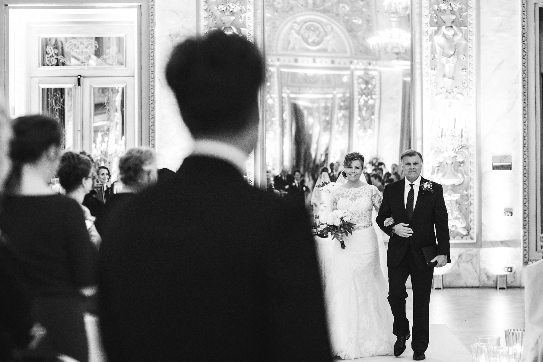 Bride and groom see each other for the first time. Luxury intimate destination wedding in Florence at St. Regis Florence
