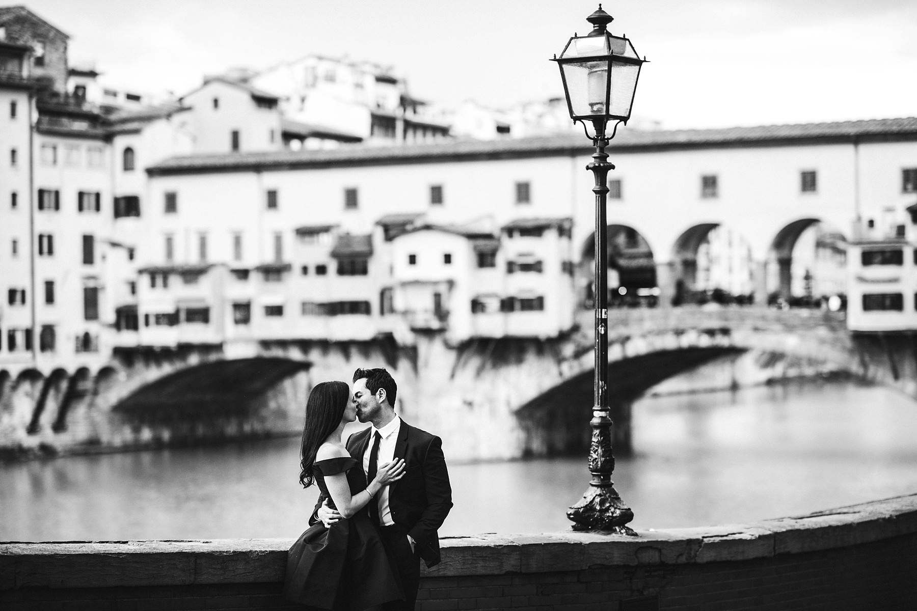 Incredible engagement photo session. Stylish photo at the Ponte Vecchio in the heart of Florence near Uffizi art Gallery Museum