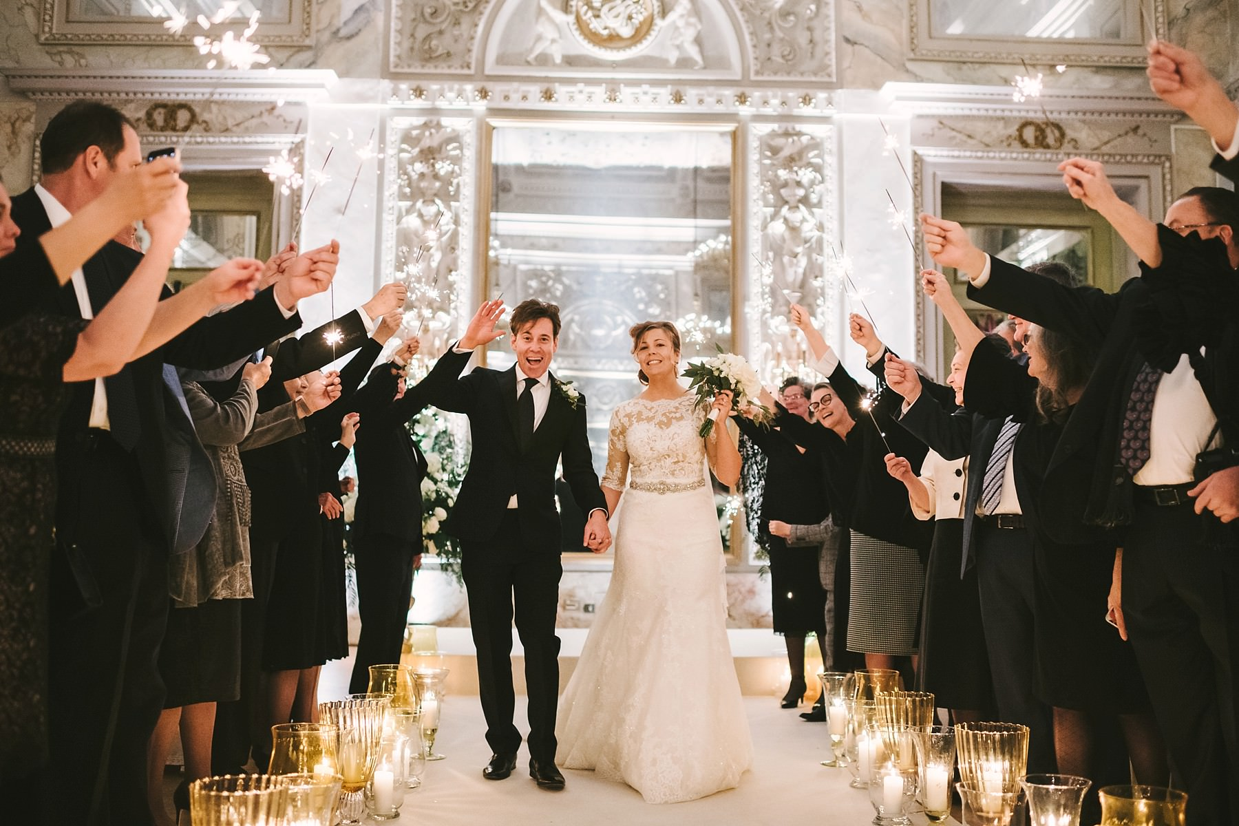 Lovely bride and groom are enjoying sparkles with guests into Sala delle Feste ballroom at Hotel St. Regis Florence