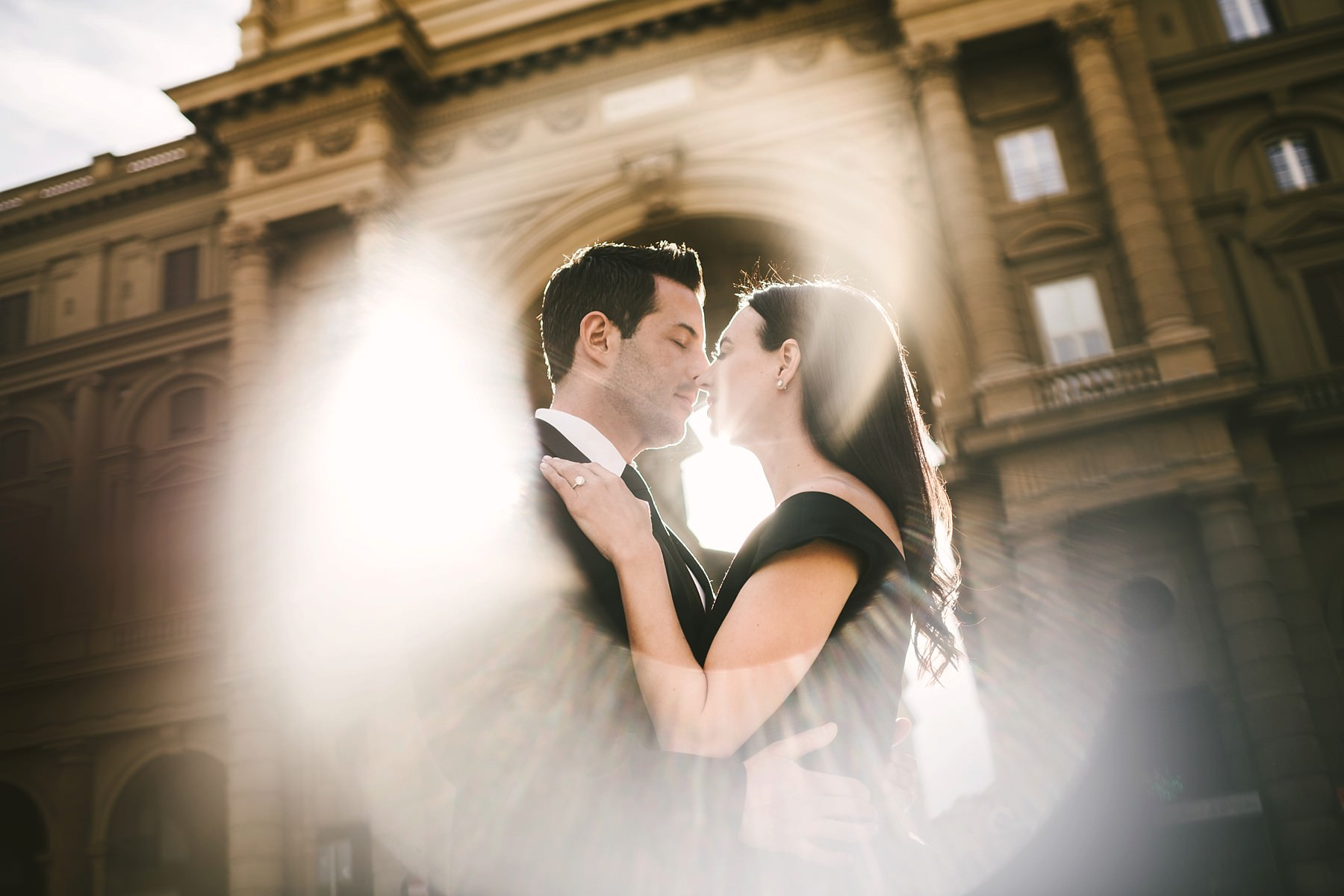Creative use of the light in this couple portrait vacation engagement photo at Piazza della Repubblica
