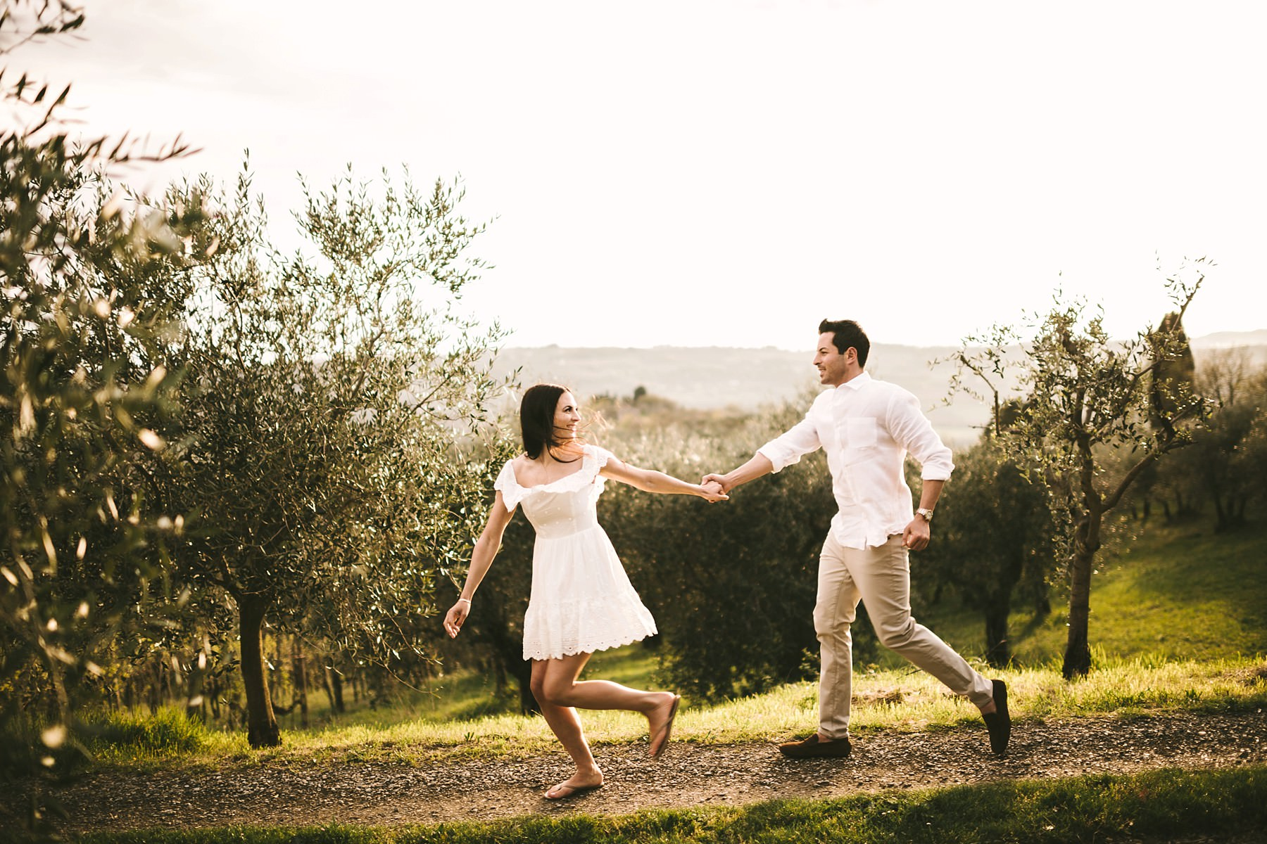 Lovely and bucolic photo in the Chianti hills countryside of Florence. Breathtaking scenery with olive trees on the background where the golden hour falls perfectly