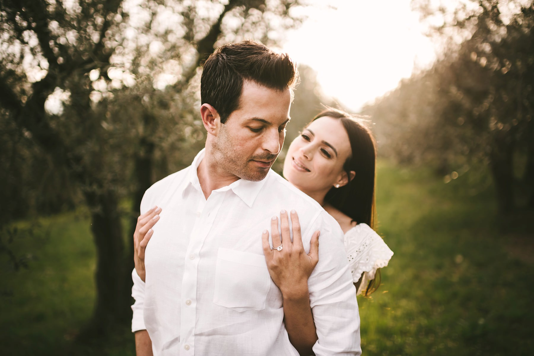 Lovely couple portrait into the gorgeous olive trees field into the Florence countryside