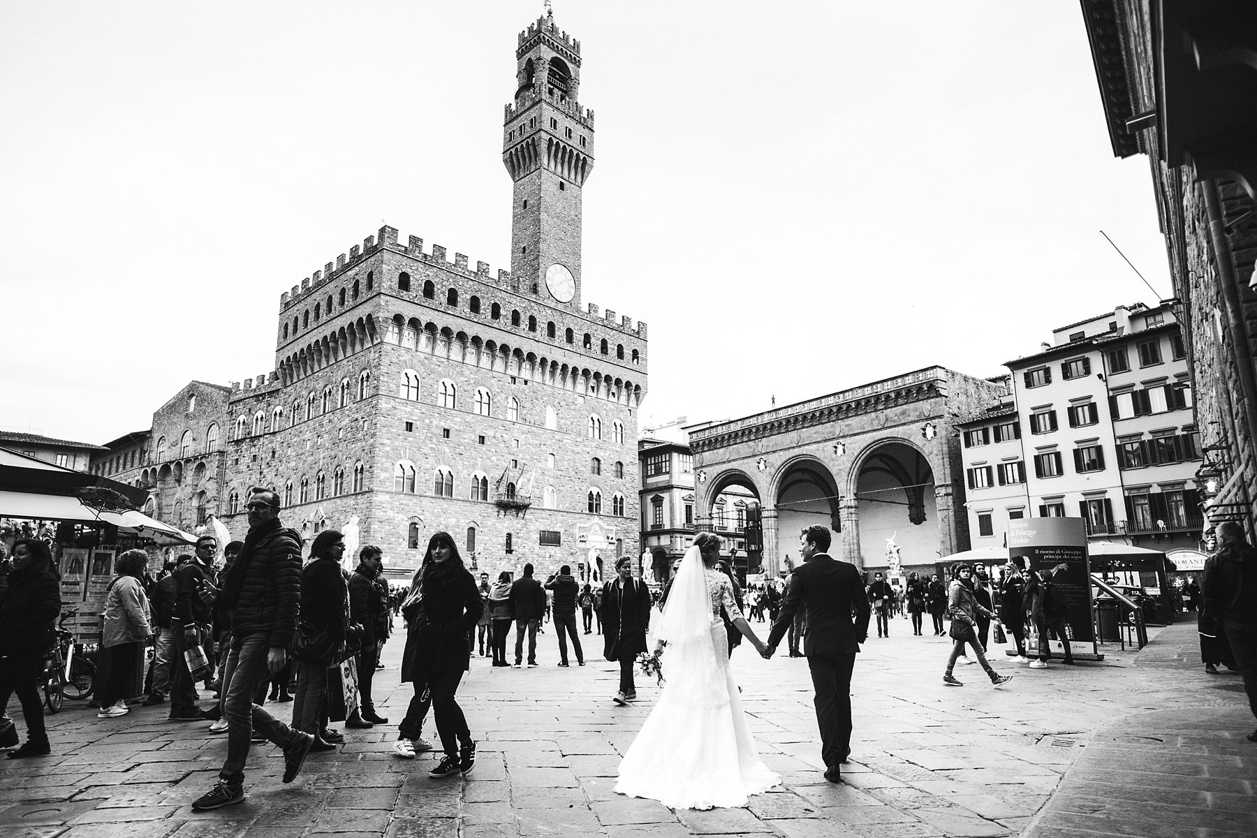Lovely bride and groom wedding photo at Palazzo Vecchio in Piazza della Signoria near Uffizi museum. Intimate and elegant destination wedding at luxury hotel St. Regis Florence