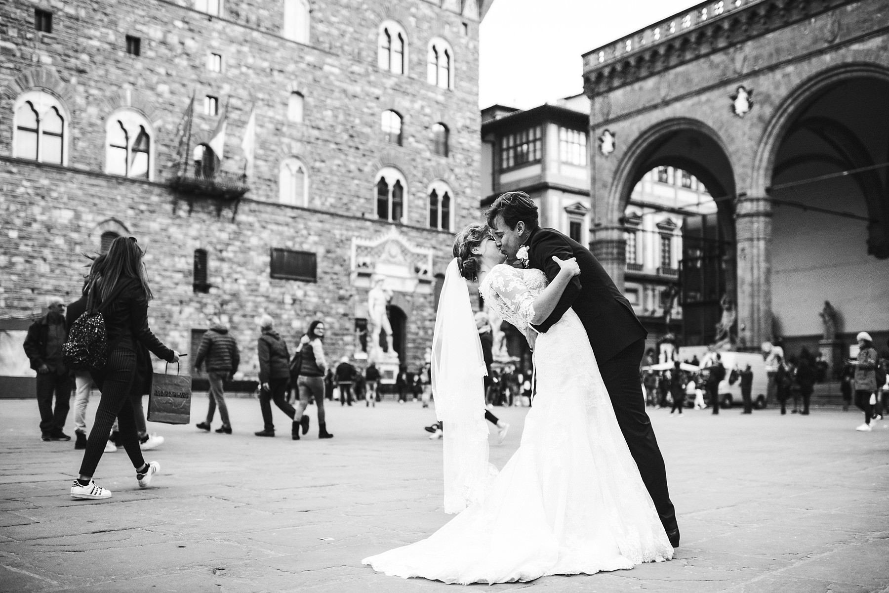 Elegant and intimate wedding photo at Palazzo Vecchio in Piazza della Signoria near Uffizi museum. Intimate and elegant destination wedding at luxury hotel St. Regis Florence