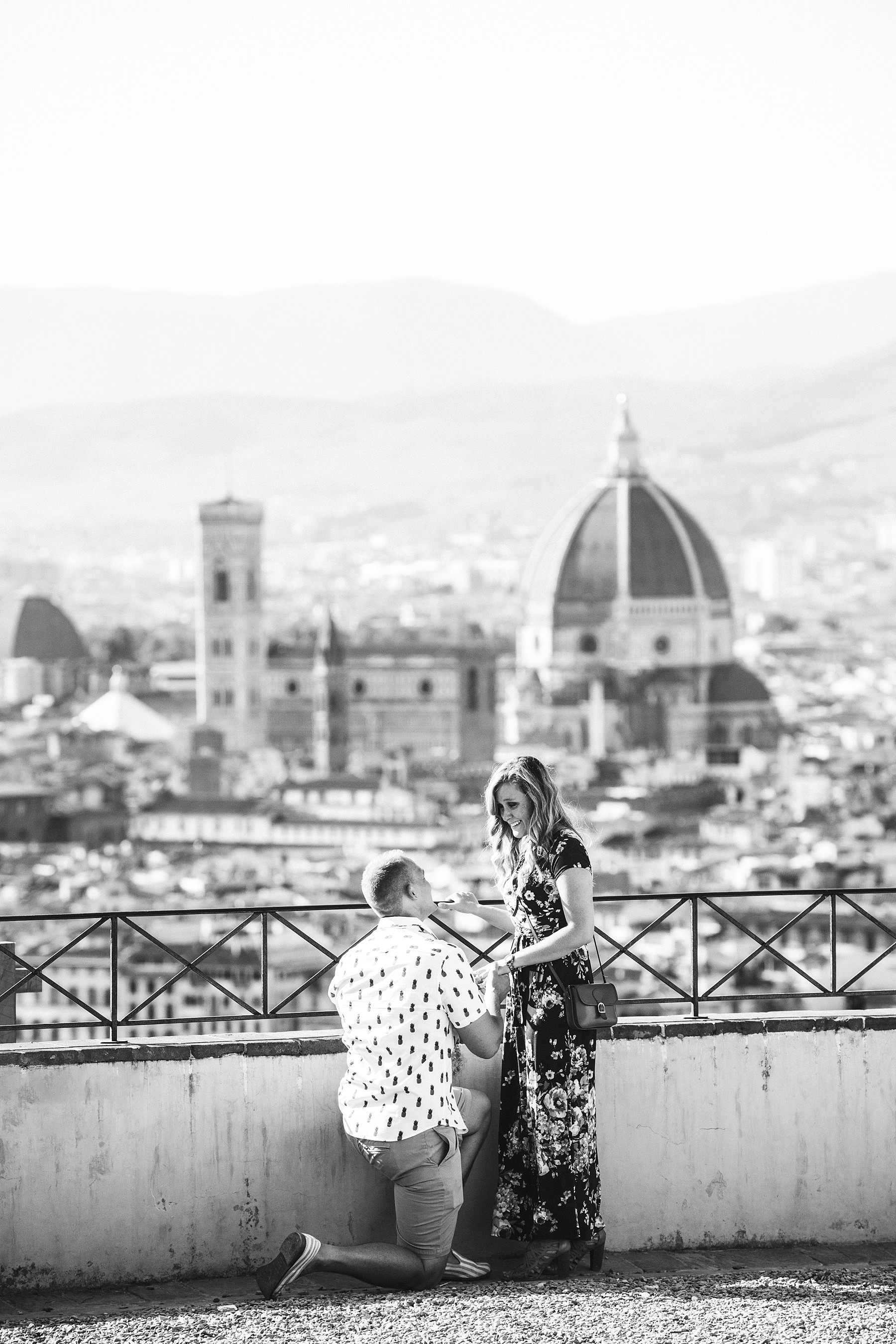Unforgettable and romantic surprise proposal photo shoot in the most beautiful panoramic place of Florence at San Miniato. Audio video recording are available as optional