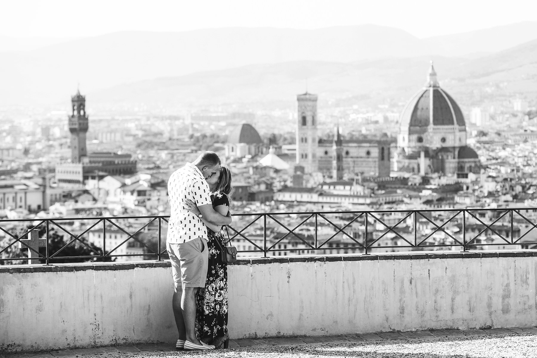 Romantic surprise proposal photo shoot in Florence at San Miniato the most beautiful panoramic place in the city. Audio video recording of the proposal is available as optional