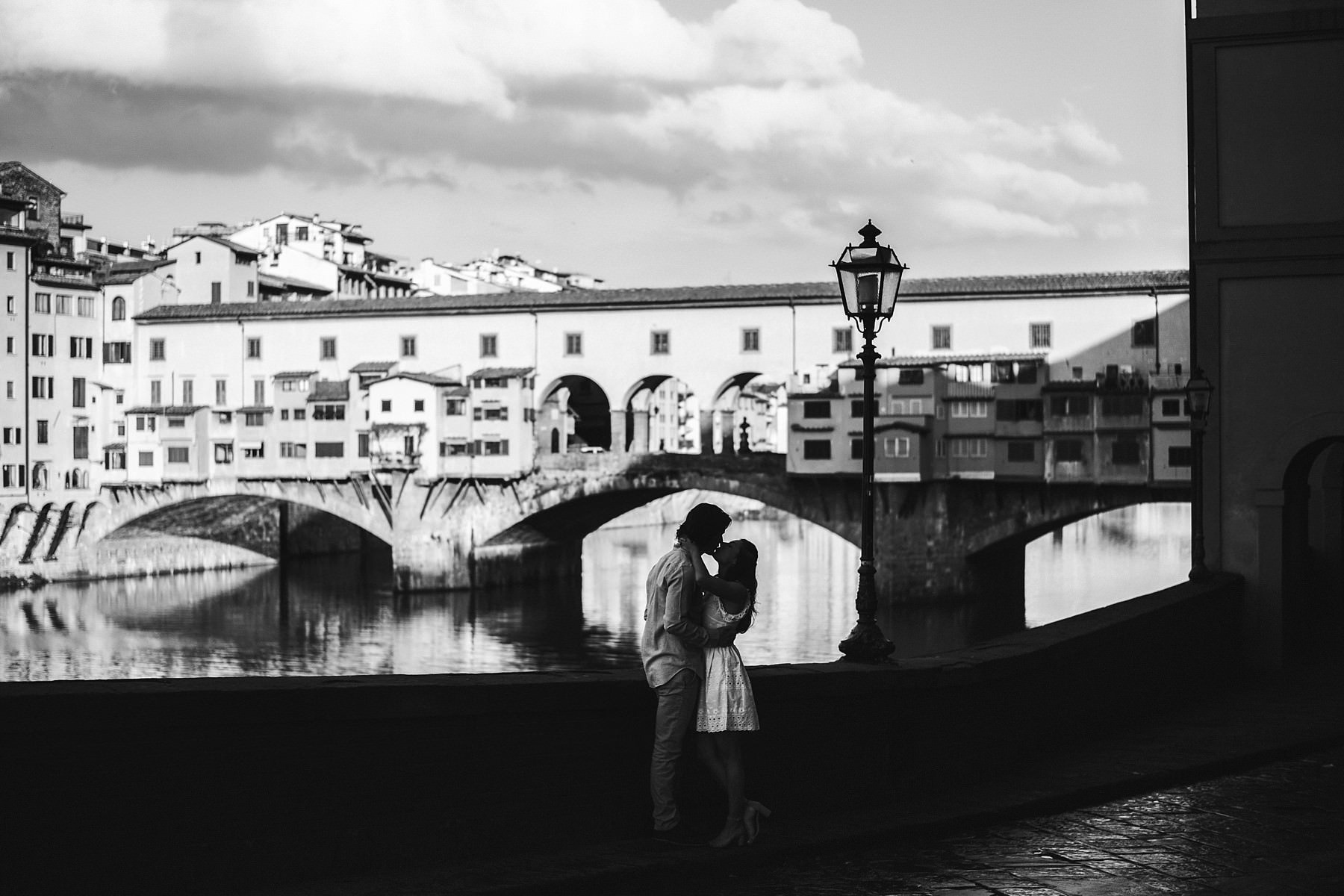 Lovely pre wedding photoshoot in Florence at sunrise. Romantic Florence engagement photo session at sunrise near Ponte Vecchio with no tourists