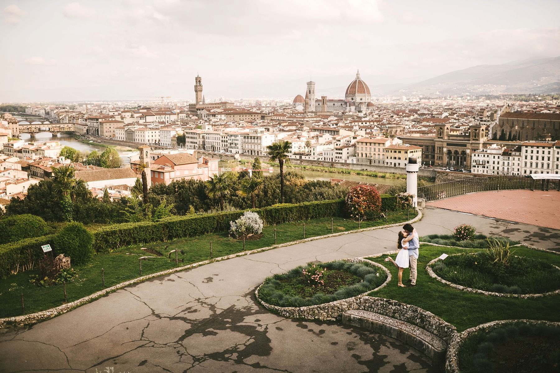 Romantic couple portrait panoramic photo at Piazzale Michelangelo, Florence at sunrise time with no tourists