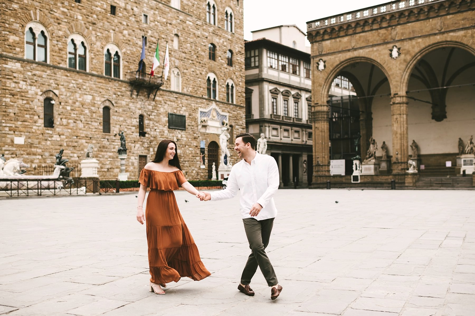 Exciting and lovely couple portrait in Florence at sunrise time. The best time to enjoy the quiet streets of Florence without any tourist around