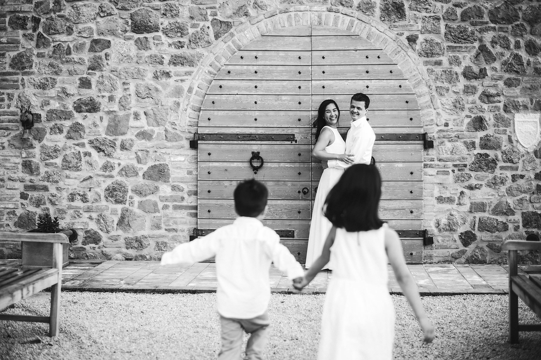 Lovely frame with a family during a summer vacation photo shoot in Tuscany near the town of Iano