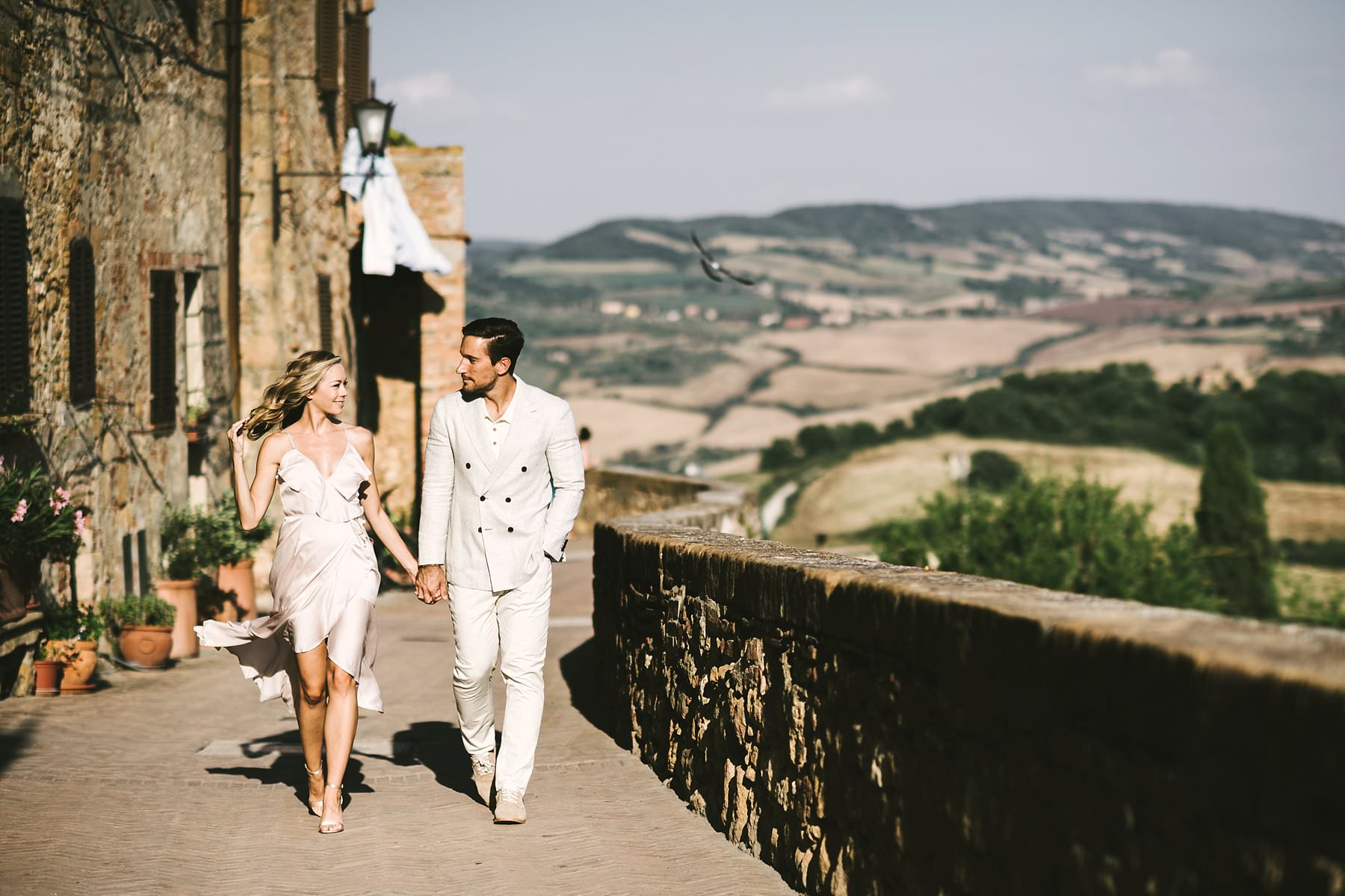 Romantic walk tour couple portrait honeymoon photo session in the historic town of Pienza