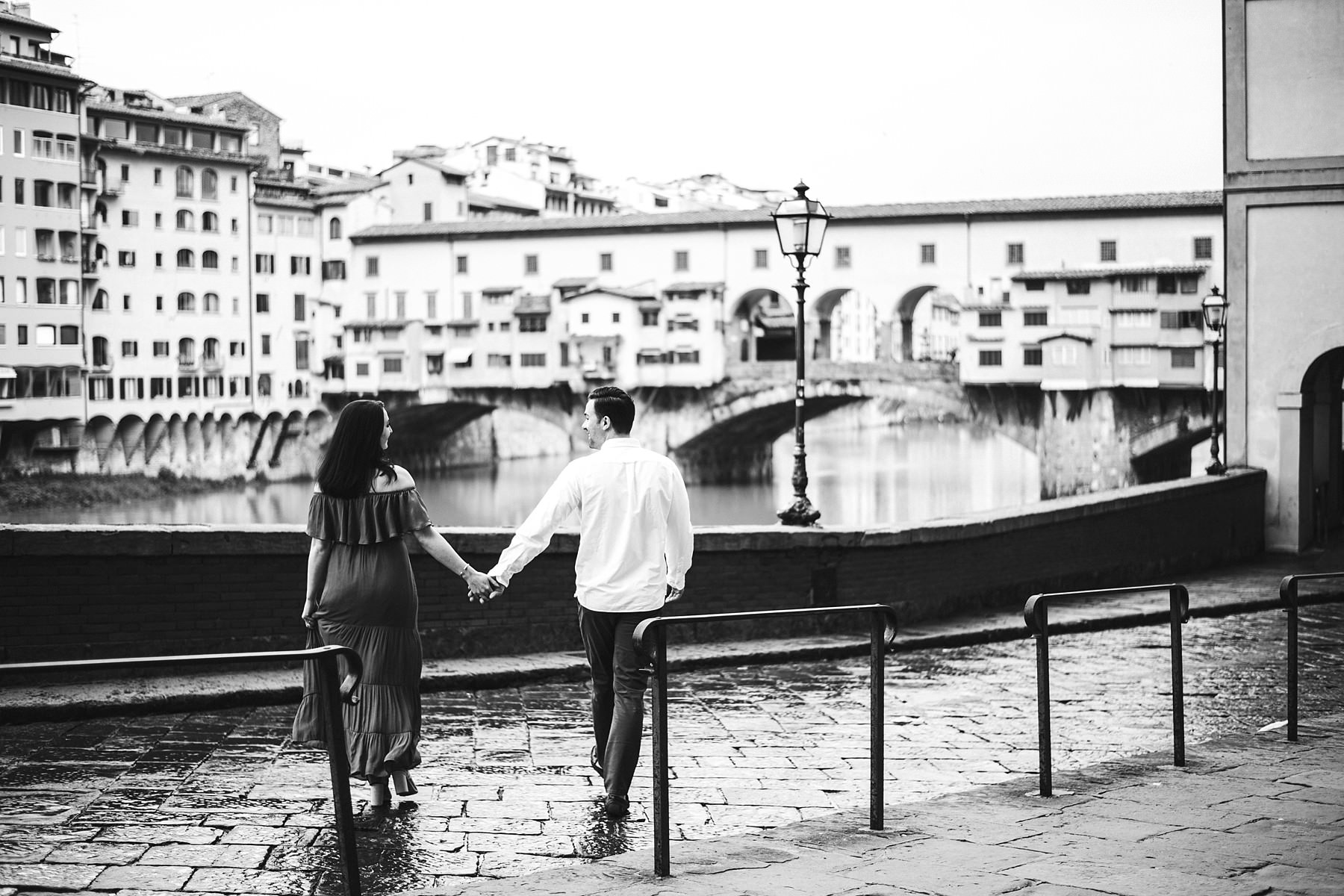 Lovely couple candid photo near Old Bridge in the early morning with anyone around. Sunrise photo session is the best to enjoy the walk tour experience photo shoot
