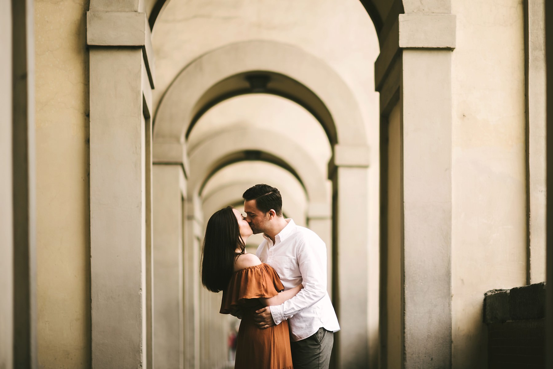 Lovely couple portrait in Florence near Ponte Vecchio at sunrise time