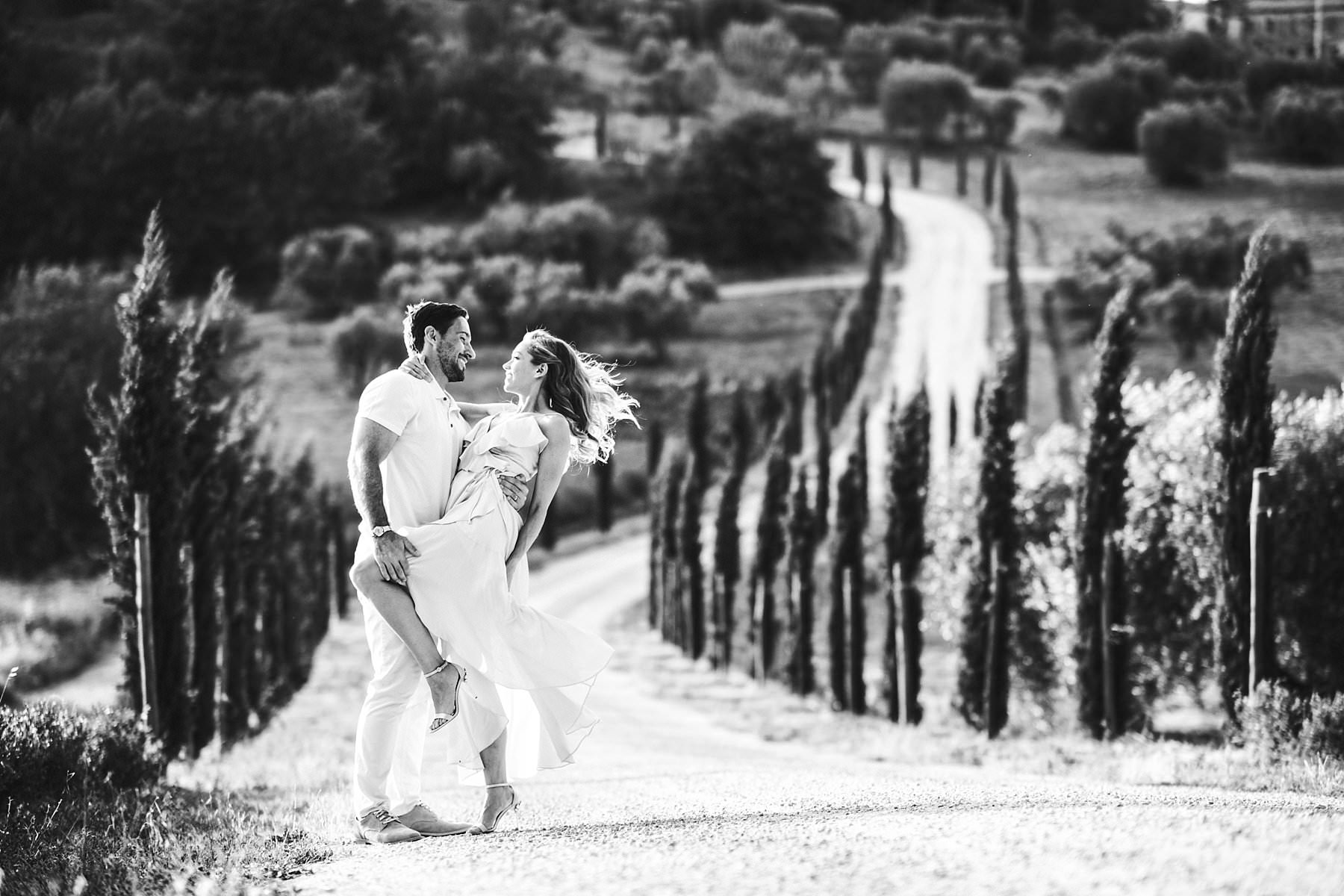 Romantic and intimate photo shoot in the real jewel of Val D'Orcia area, the countryside with cypresses streets and rolling hills as background