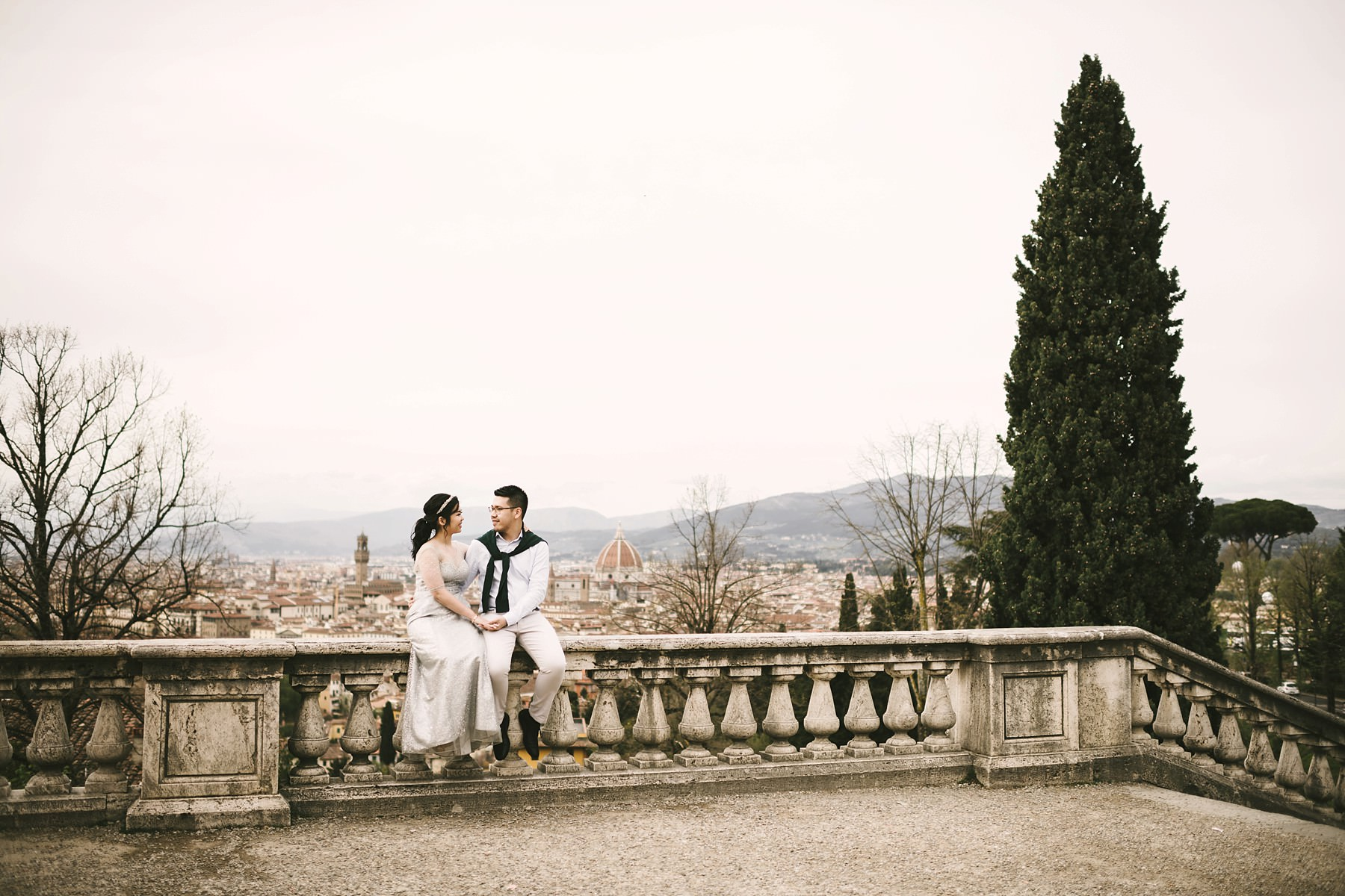 Lovely couple recently engaged. Florence couple portrait photo shoot at San Miniato al Monte near Piazzale Michelangelo