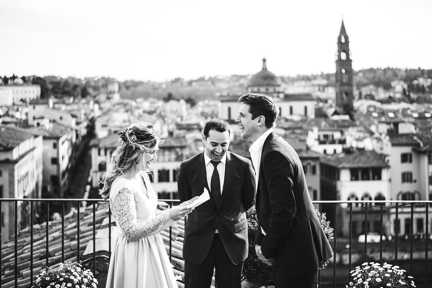 Emotional and exciting vows renewal photo shoot in Florence at Antica Torre Tornabuoni top terrace with a breathtaking view of the city
