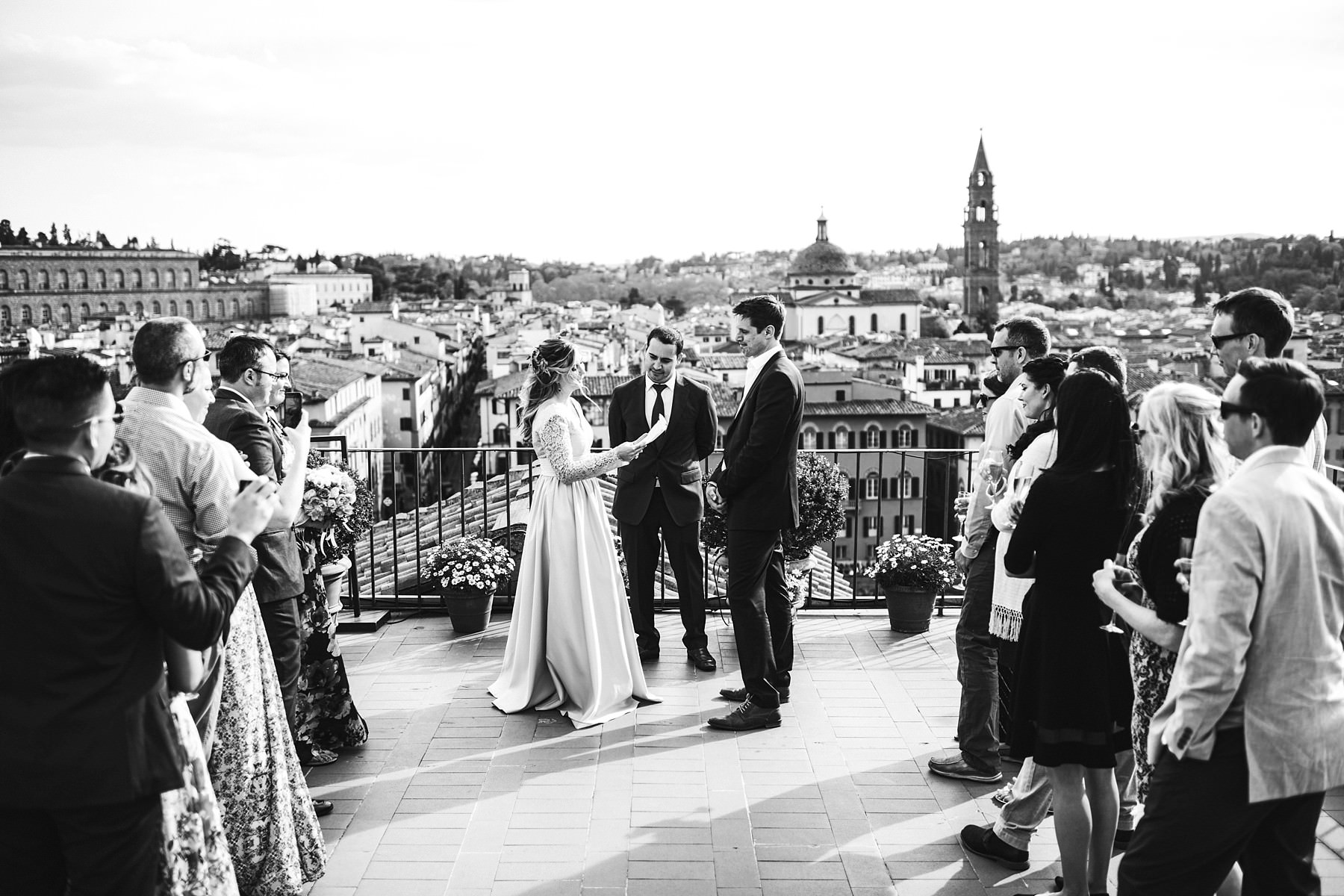 Intimate and beautiful unforgettable vow renewal ceremony in Florence at Antica Torre Tornabuoni top terrace