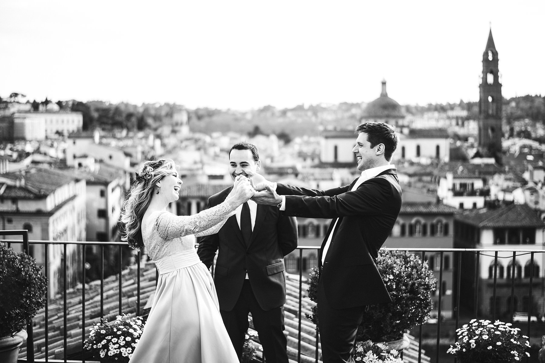 Unforgettable intimate vows renewal photo shoot in Florence at top terrace Antica Torre Tornabuoni located in the most icon center of Florence near Ponte Vecchio