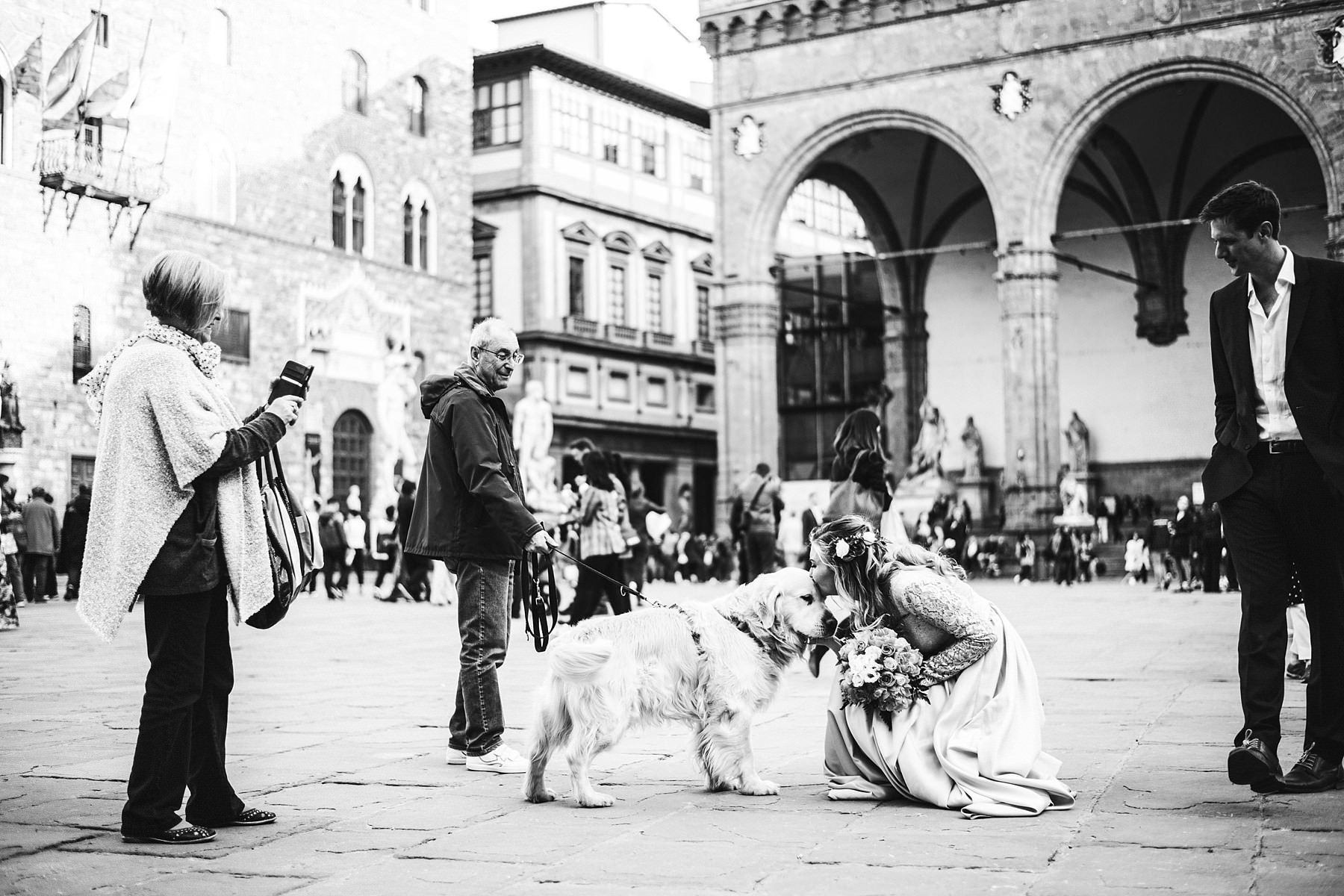 Lovely bride with a new friend in Piazza della Signoria in Florence