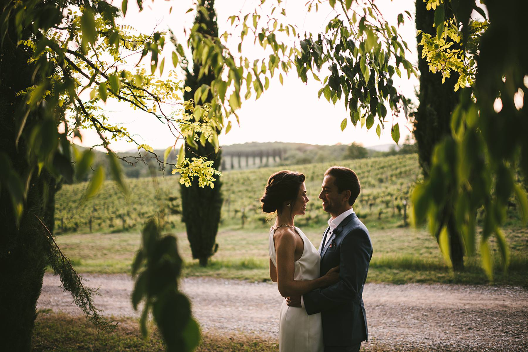 Romantic and elegant pre-wedding photo shoot in Tuscany near vineyard and cypresses street at the historic estate of Villa La Selva Wine Resort