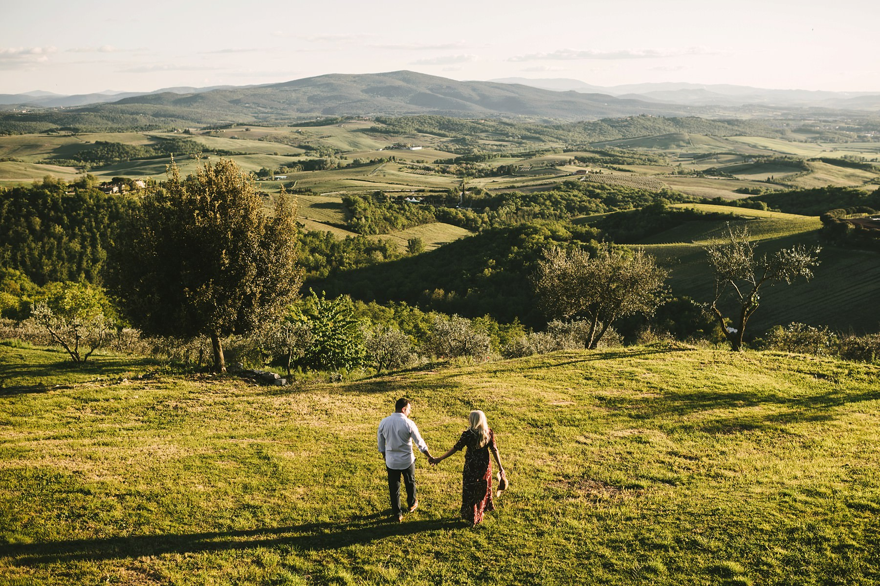 Dream comes true. Elegant couple portrait during honeymoon vacation photo session in Tuscany at amazing venue of Castello La Leccia