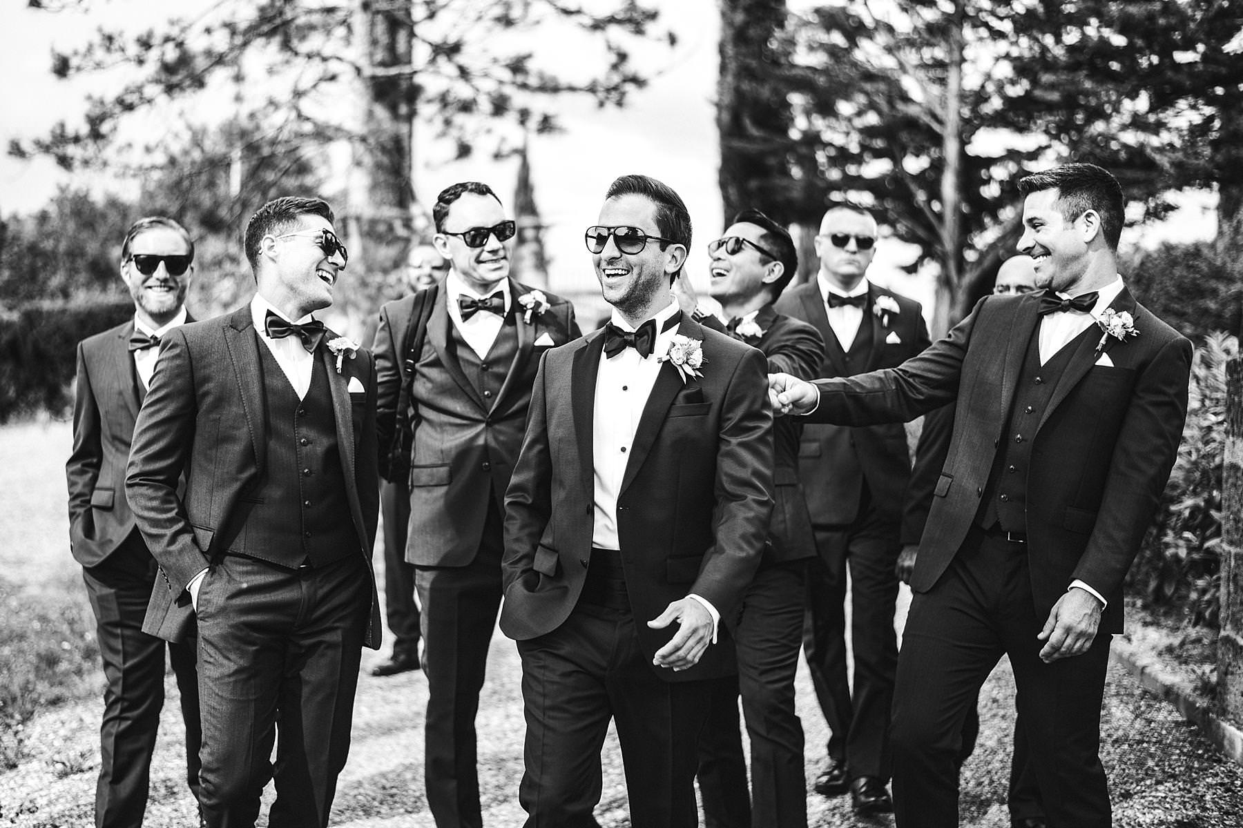 Exciting groom and the mens just before to walk down the outdoor aisle. La Dolve Vita style destination wedding in Tuscany at the historic estate of Villa La Selva Wine Resort in Tuscany