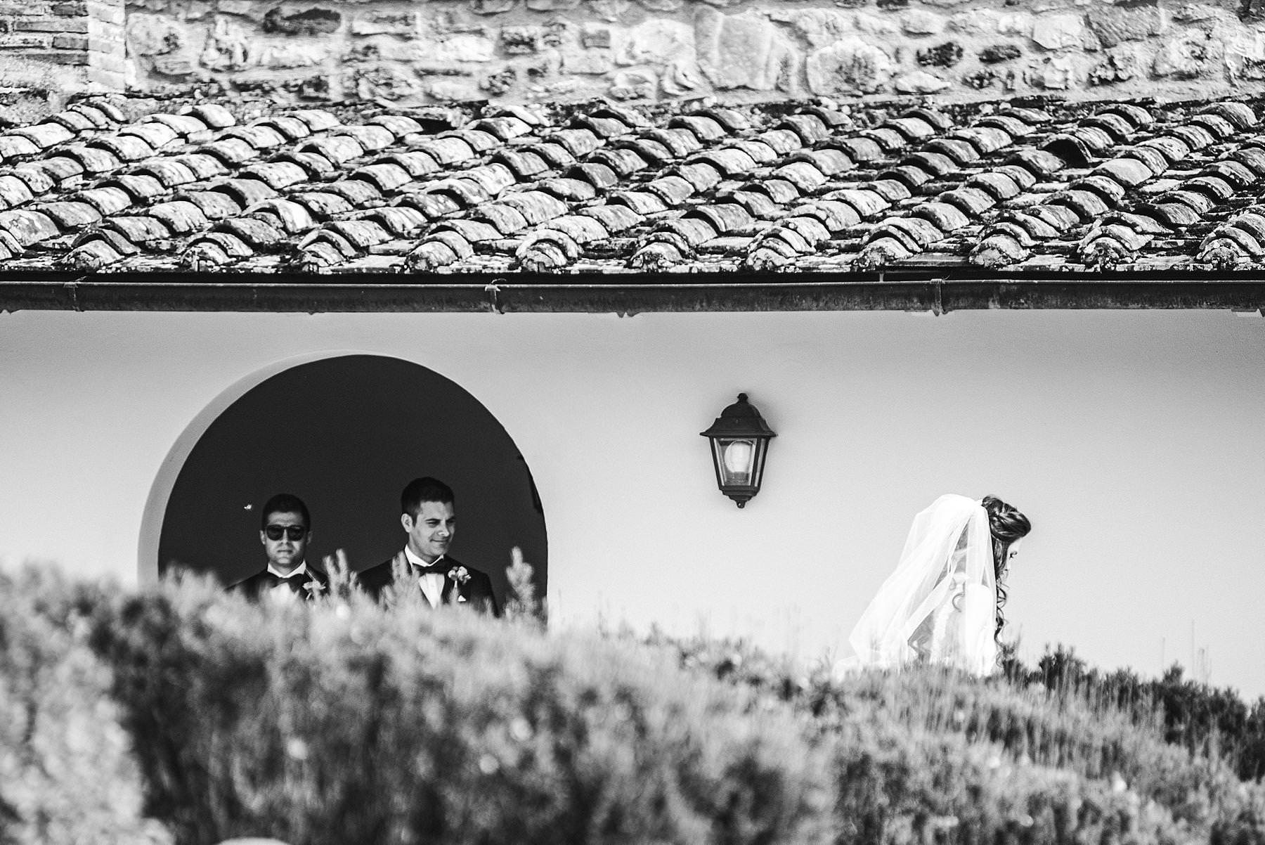 Lovely moment of the bride just walk to the groom for the first look at the historic estate of Villa La Selva Wine Resort in Tuscany