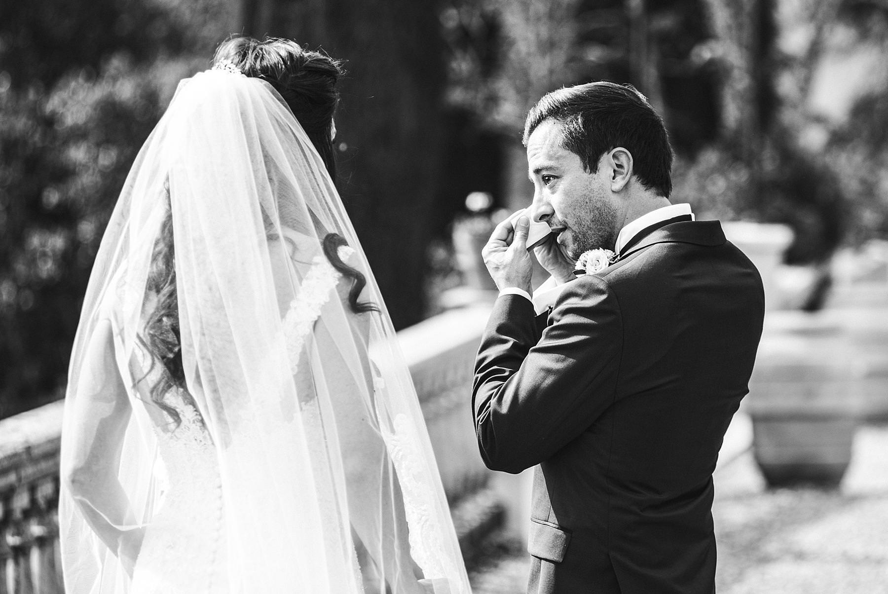 Emotional moment during bride and groom first look in Tuscany destination wedding at Villa La Selva