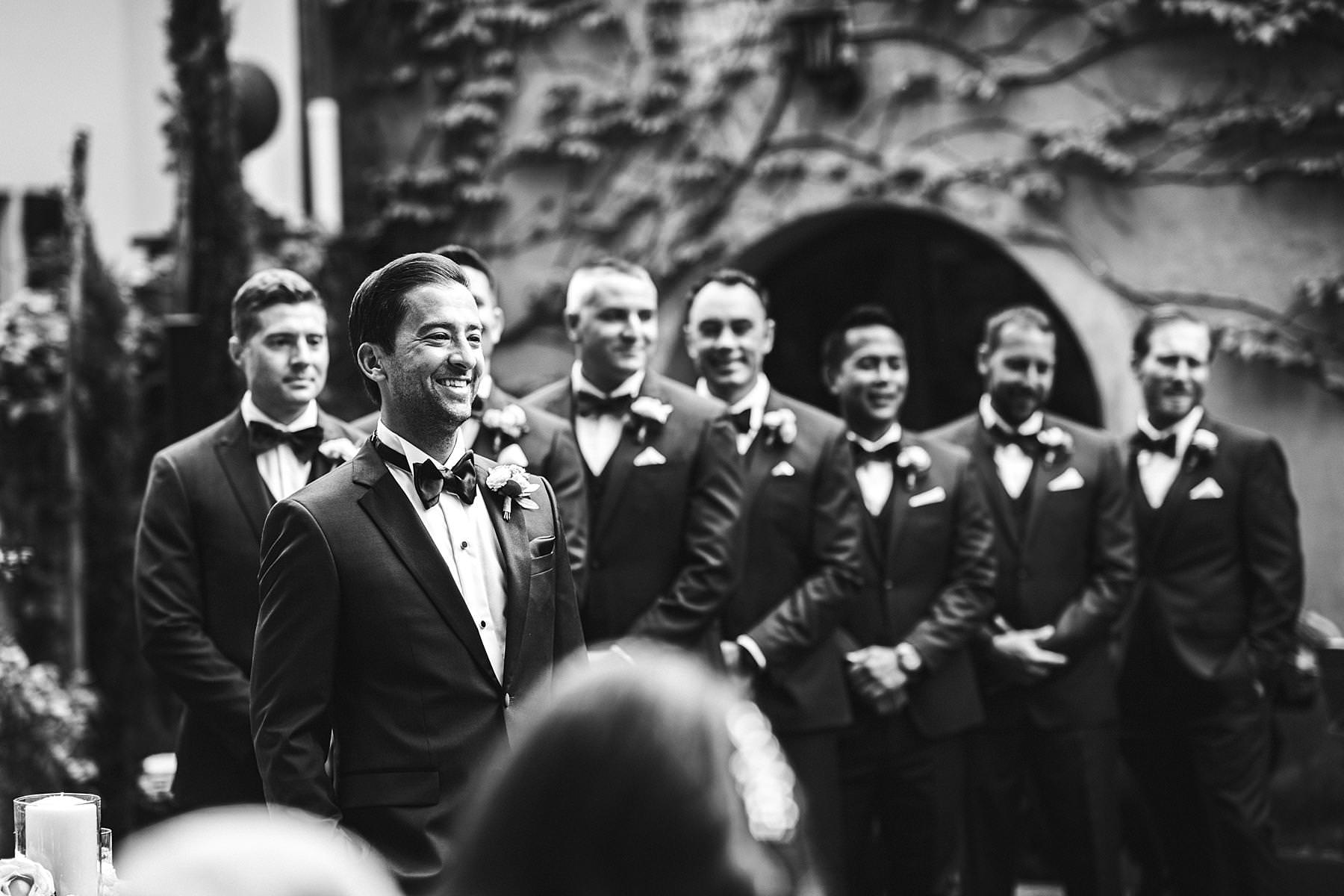Lovely groom smiles to his elegant bride. Elegant La Dolce Vita style destination wedding in Tuscany at the historic estate of Villa La Selva Wine Resort