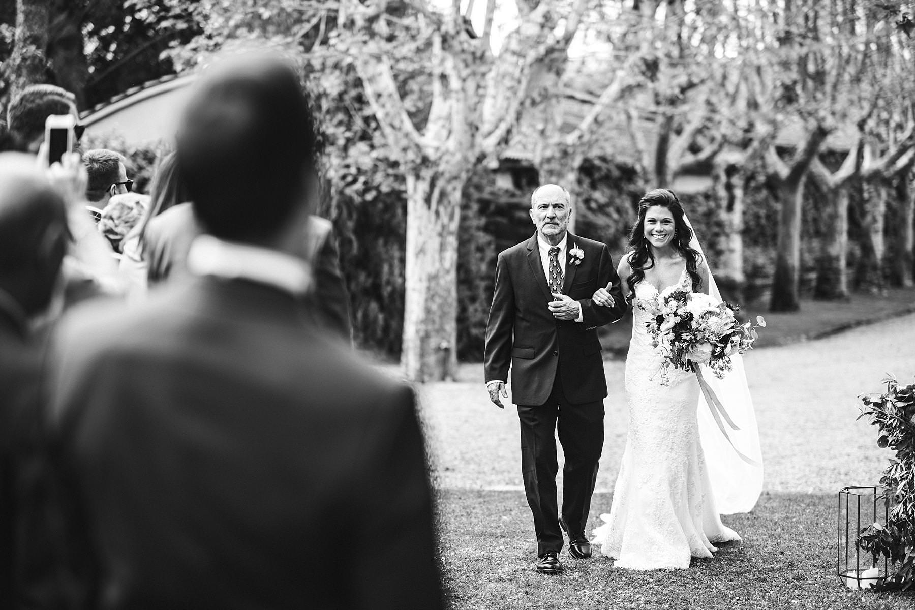Bride and father walks down the aisle. Elegant destination wedding in Tuscany countryside at Villa La Selva