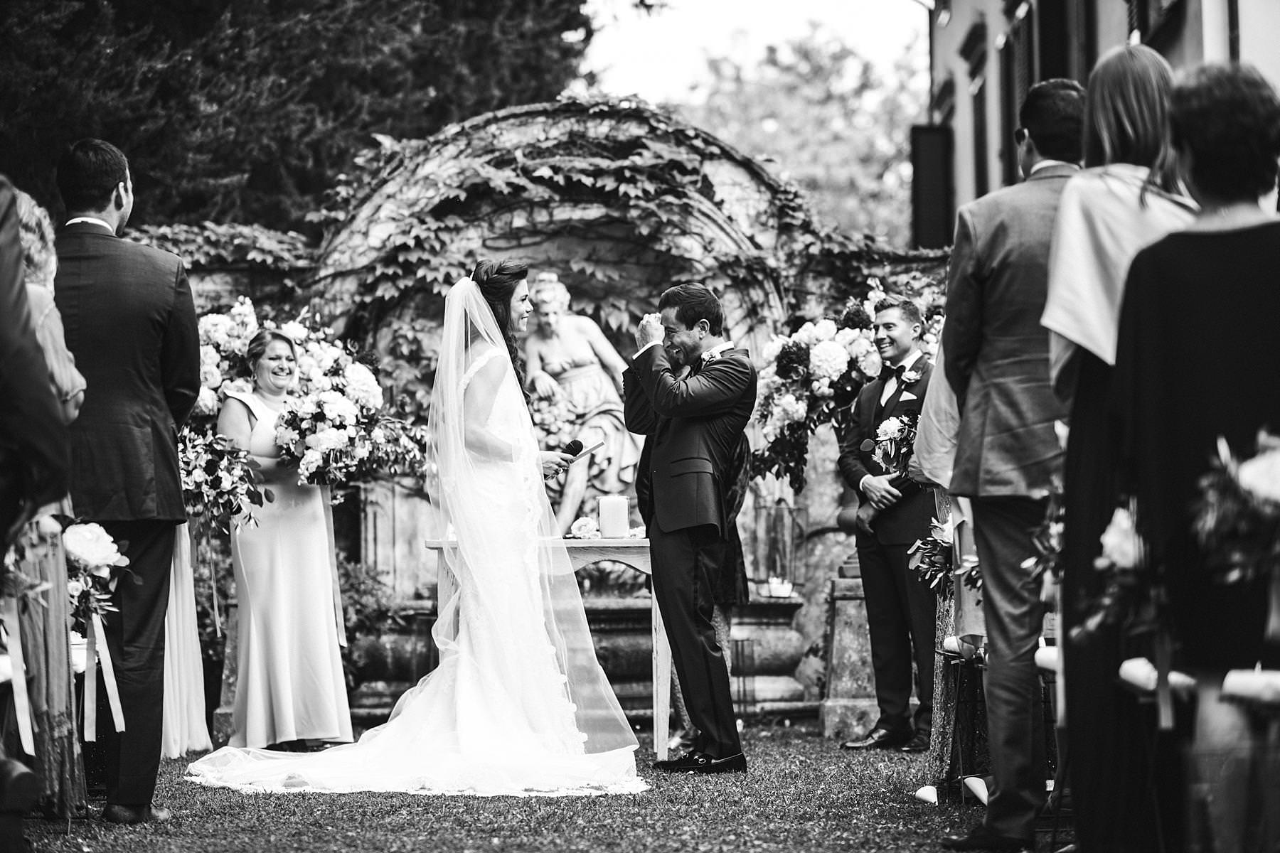 Bride and groom emotional vows in the outdoor ceremony at the historic venue of Villa La Selva Wine Resort