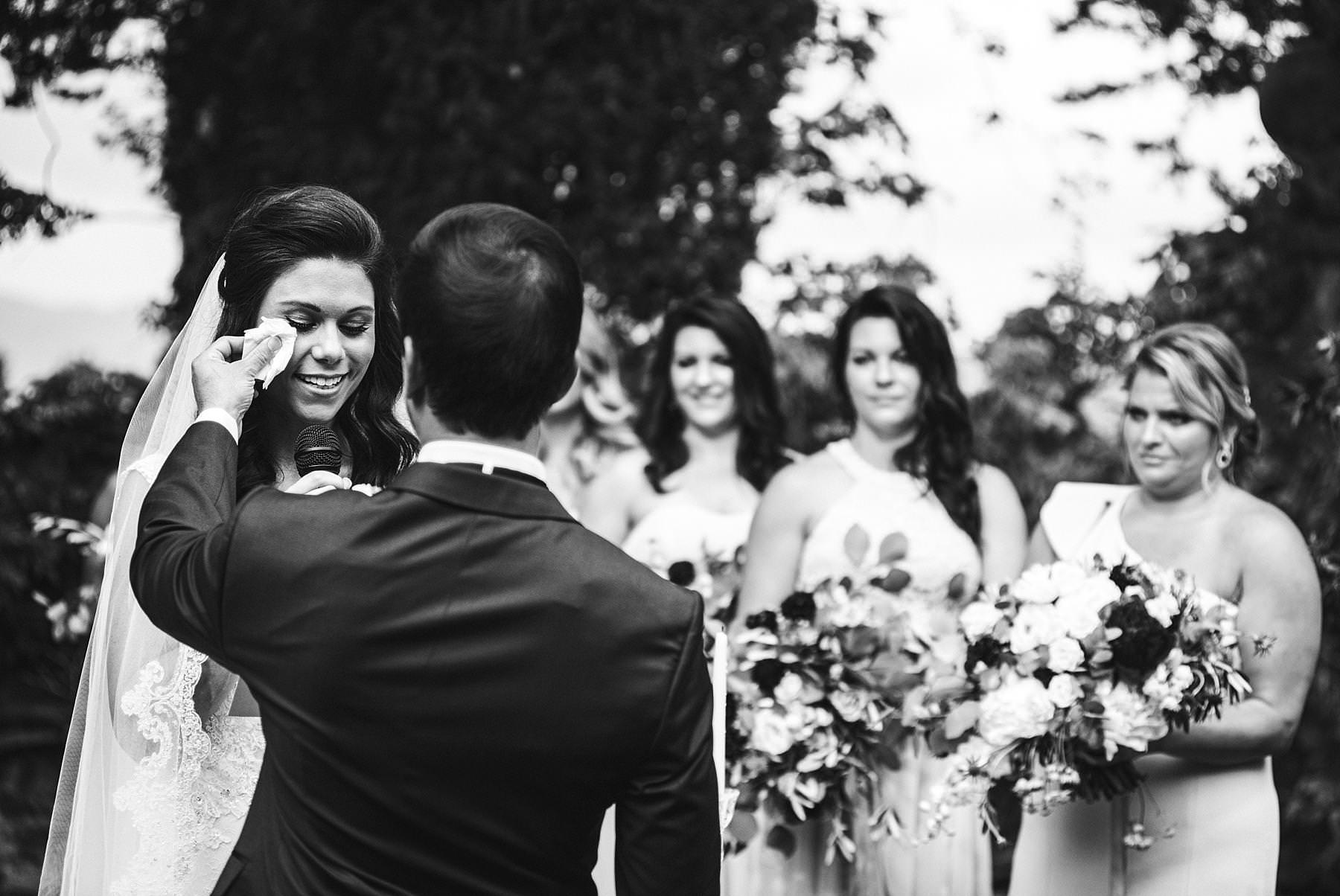 Emotional and unforgettable moment during bride and groom exchanging of the vows at Villa La Selva Wine Resort destination wedding