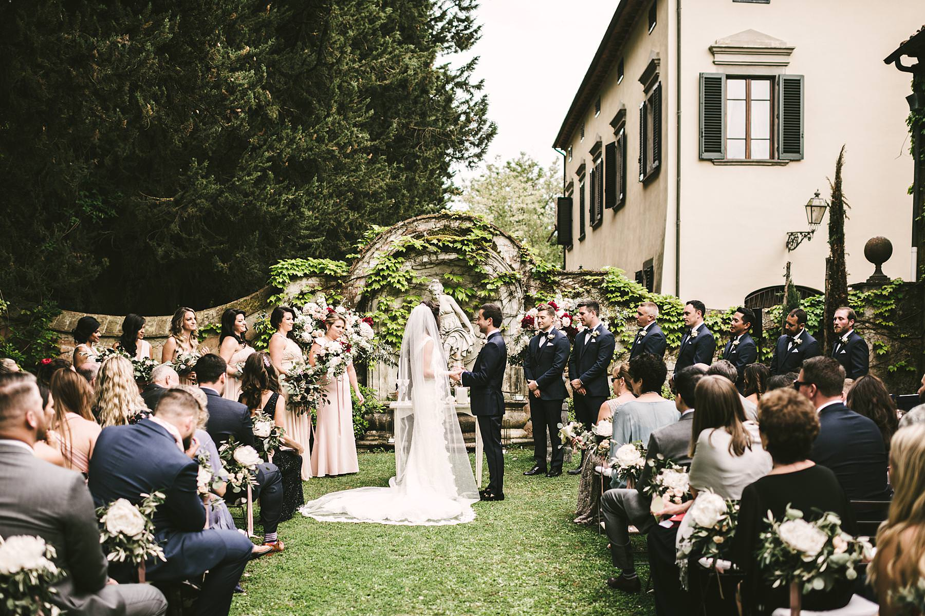 Outdoor destination wedding in Italy at historic estate of Villa La Selva Wine Resort located in the countryside of Tuscany