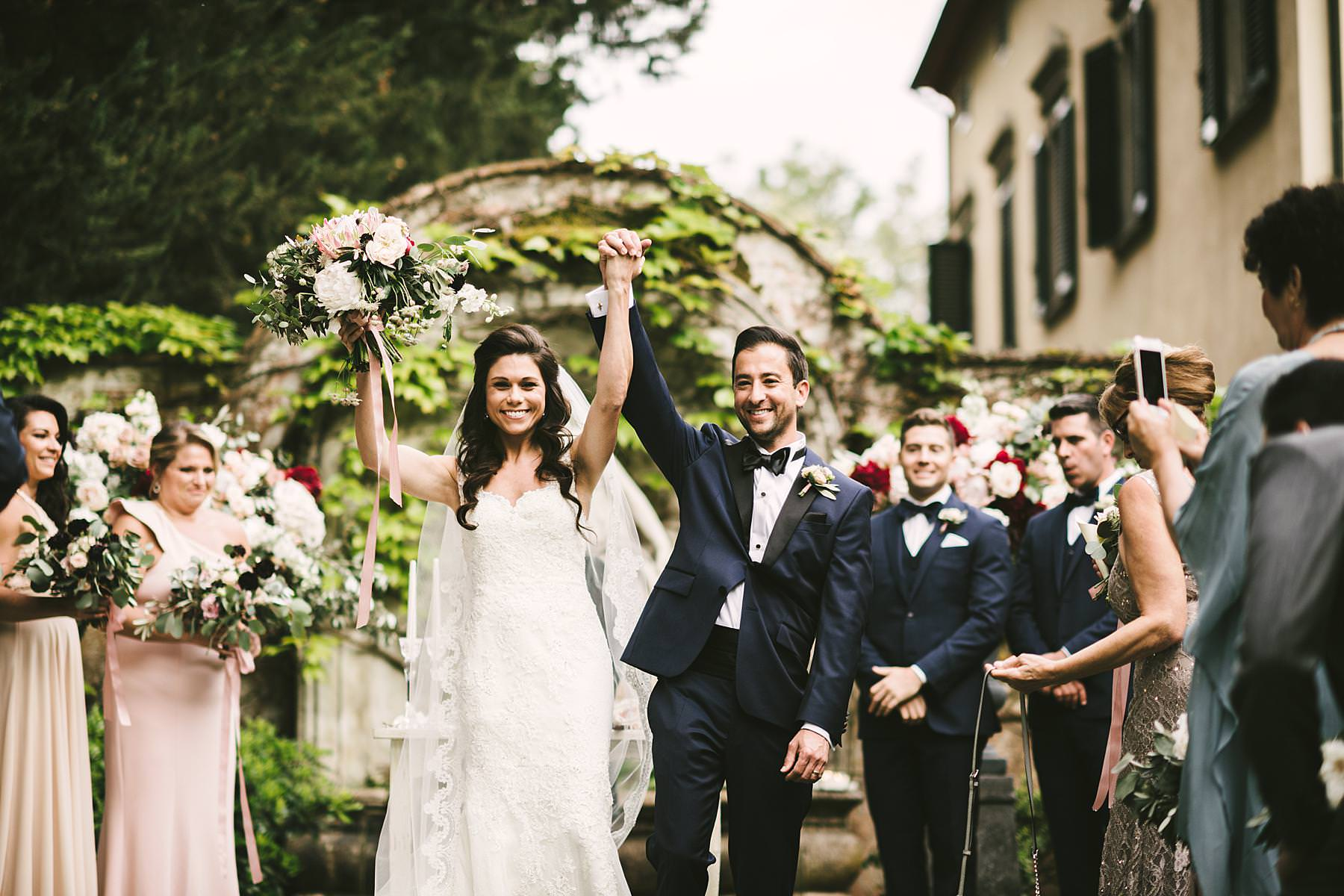 Bride and groom just married in Tuscany lovely venue of Villa La Selva in the countryside of Tuscany. La Dolce Vita Style destination wedding planned by the Italian Wedding Designer planning agency