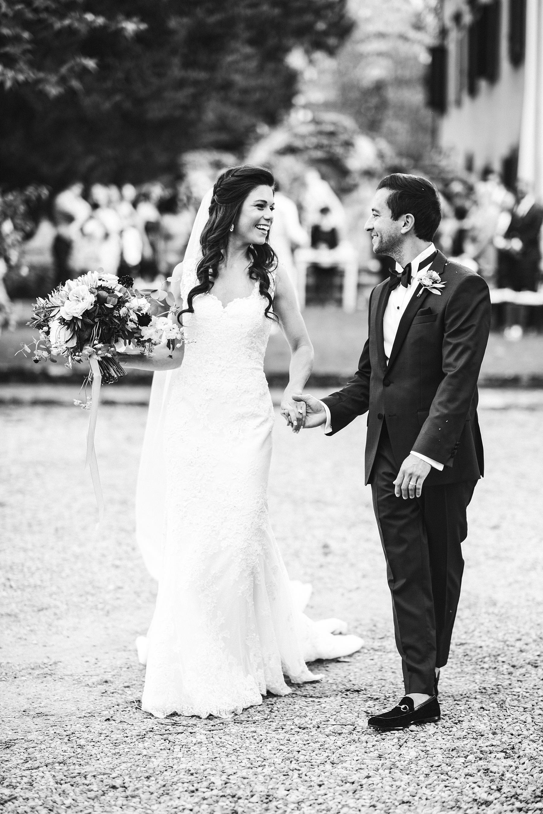 Elegant bride and groom. La Dolce Vita style destination wedding in Italy at historic estate of Villa La Selva Wine Resort located in the beautiful Tuscany countryside