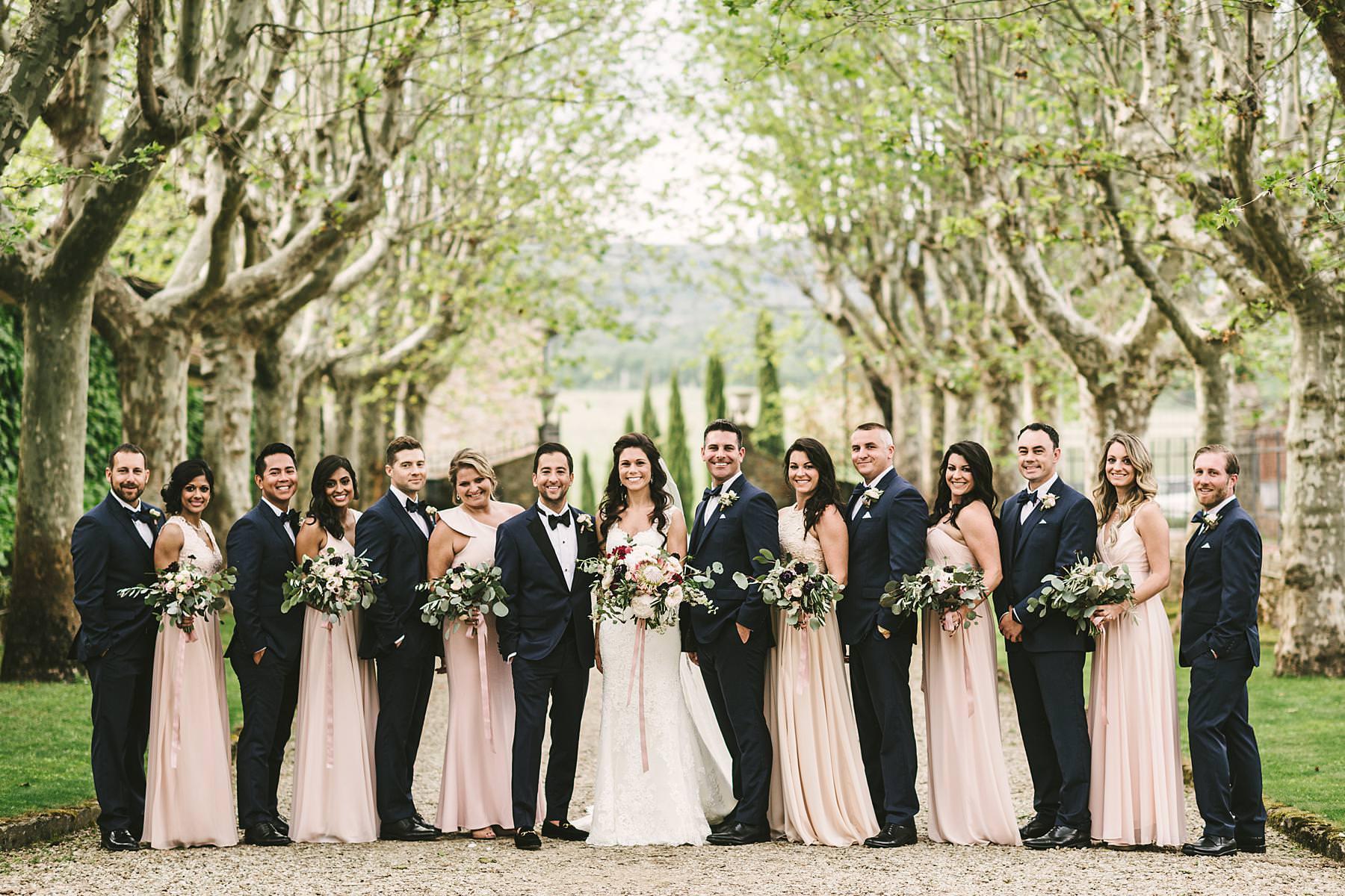 La Dolce Vita Style destination wedding in Tuscany countryside. Villa La Selva Wine Resort bridal party wedding photo