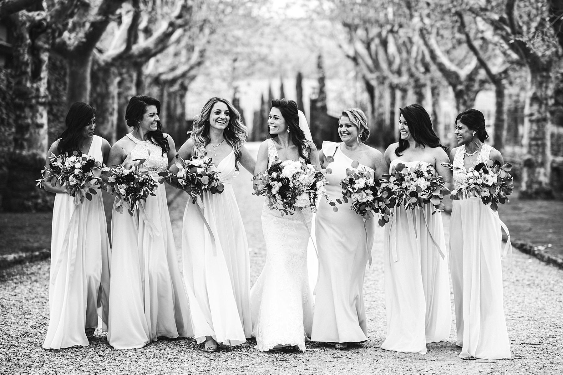 Bride in Pronovias wedding gown and bridesmaids photo. Elegant destination wedding in Tuscany at historic venue of Villa La Selva Wine Resort