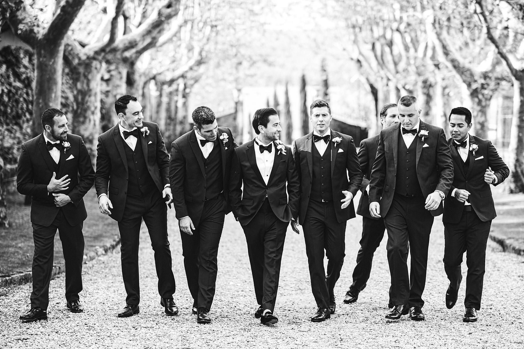 Cool groom and the mens wedding photo just after the outdoor ceremony took place at Villa La Selva Wine Resort in Tuscany countryside