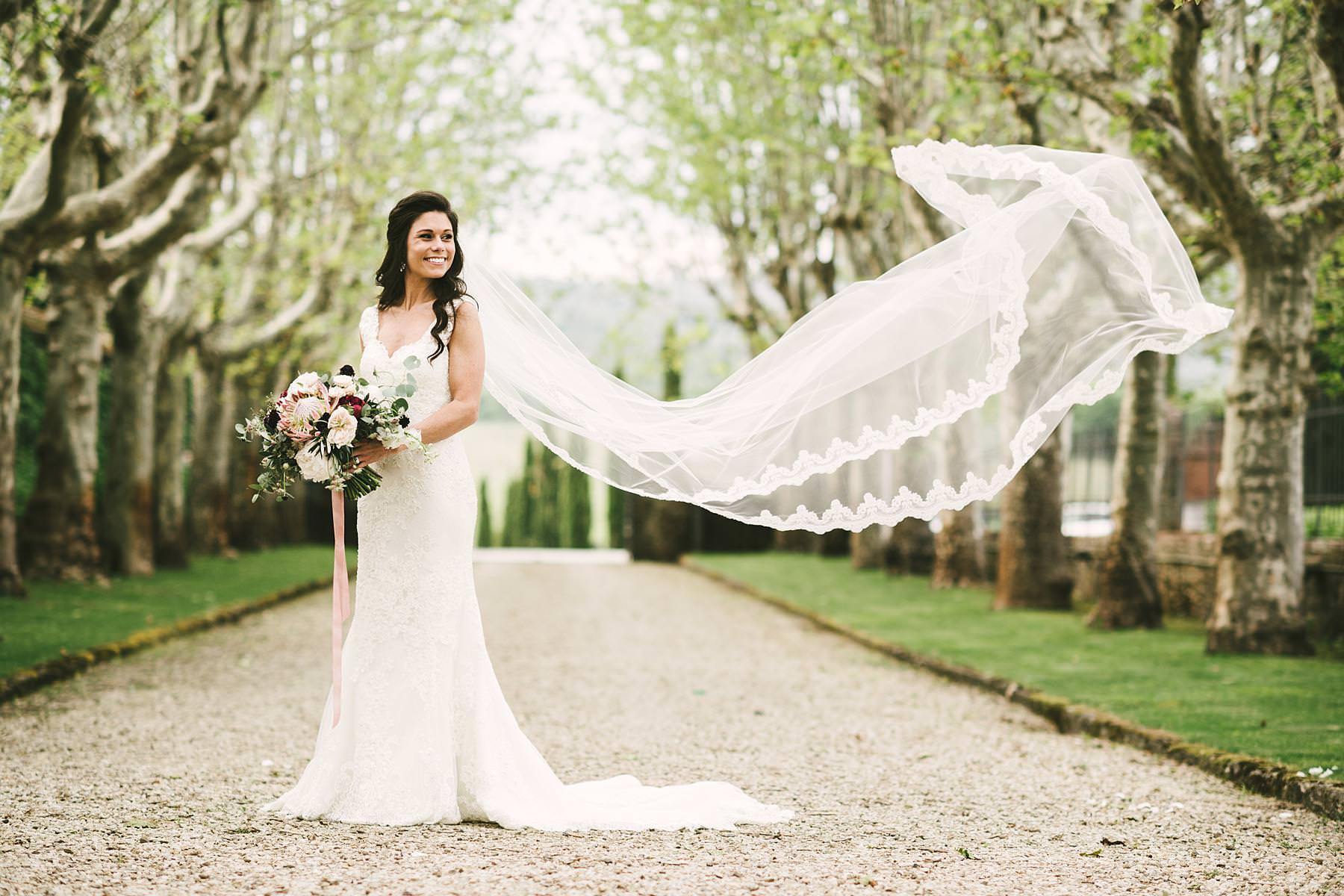 Elegant bride Juliana in Pronovias wedding gown at historic estate of Villa La Selva Wine Resort. Destination wedding in Italy
