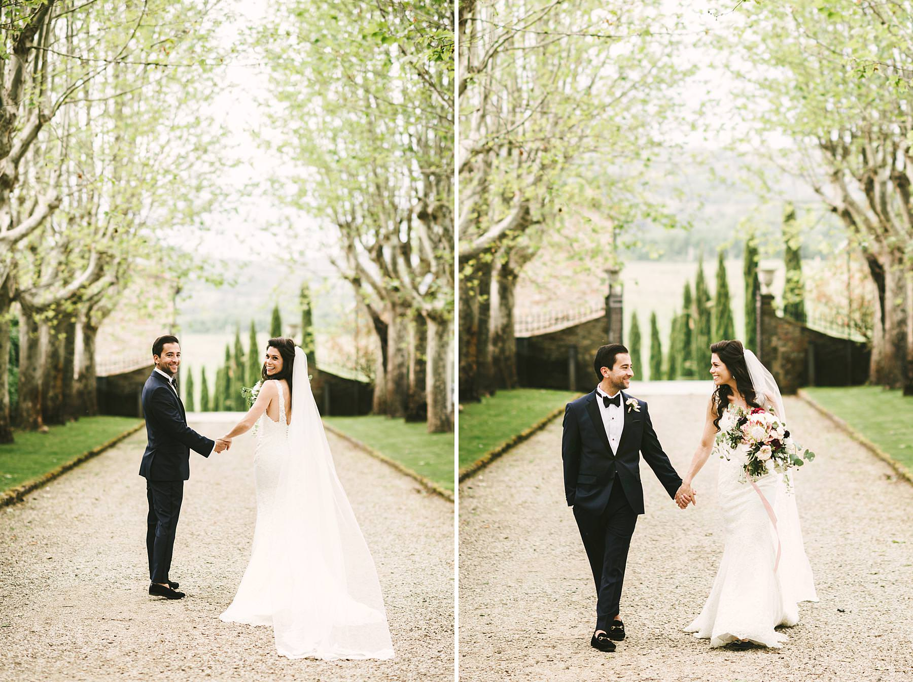 Elegant bride and groom wedding portrait in the tresses street at Villa La Selva Wine Resort historic estate in the Tuscany countryside
