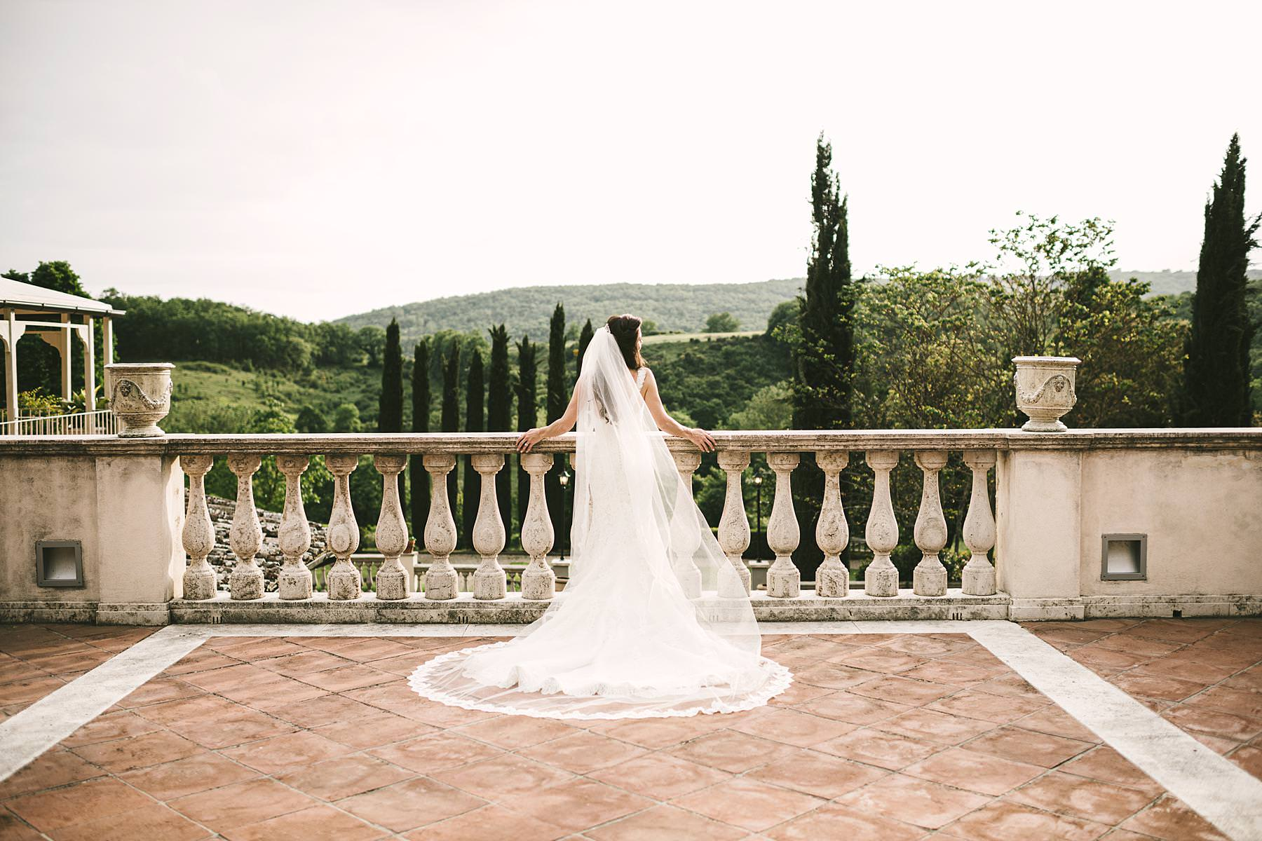 Beautiful bride in Pronovias wedding gown in the magical atmosphere of Tuscany countryside venue of Villa La Selva