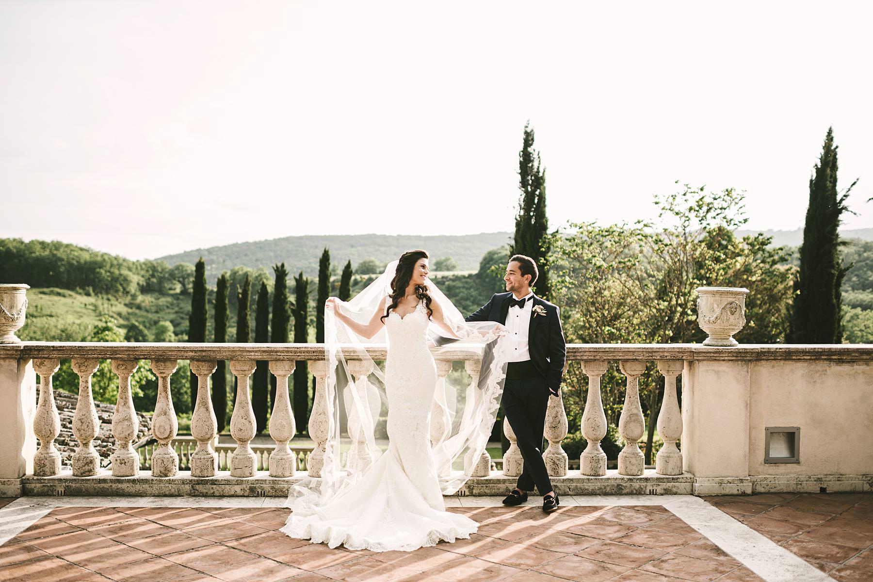 Beautiful bride and groom portrait at Villa La Selva venue for destination wedding event in Tuscany countryside