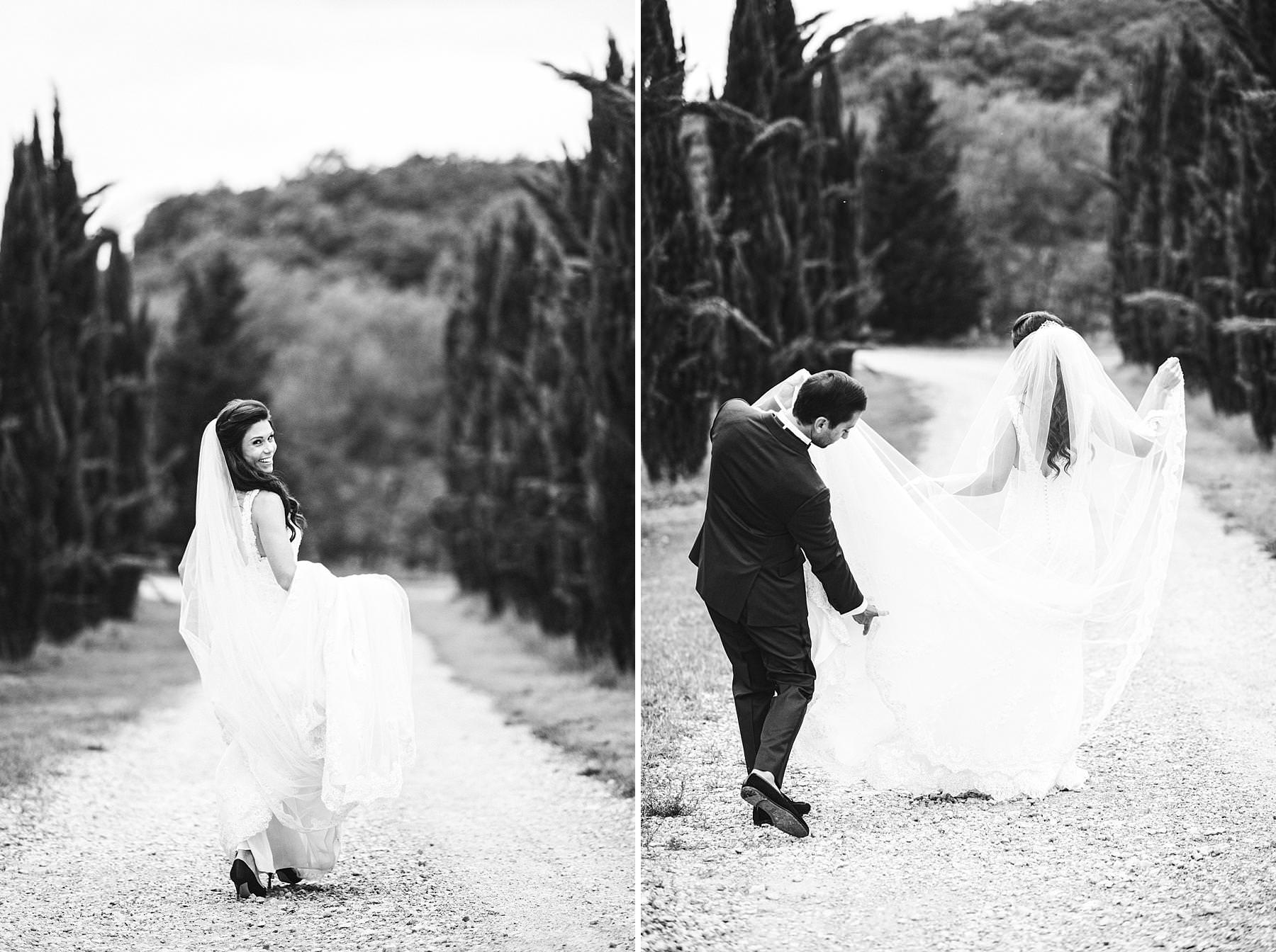 Lovely bride and groom wedding photos in the evocative cypresses street of Villa La Selva Wine Resort