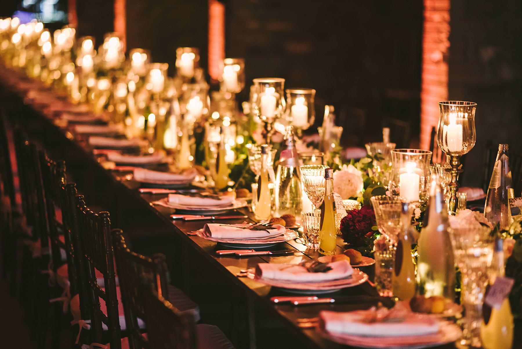 Lovely elegant indoor destination wedding dinner decor at historic estate of Villa La Selva Wine Resort in Tuscany countryside