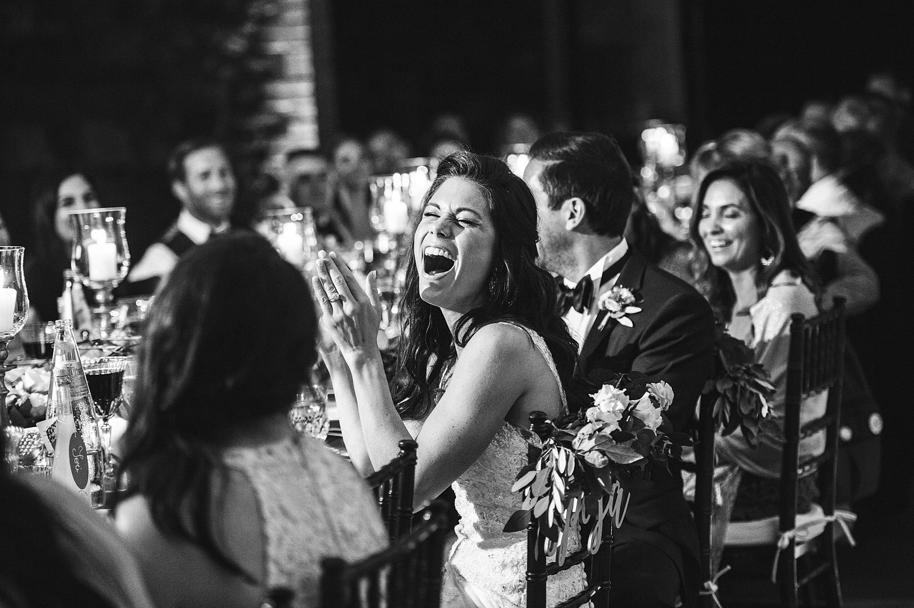 Reportage candid photo during reception dinner speech at Villa La Selva Wine Resort. Elegant destination wedding in Tuscany countryside