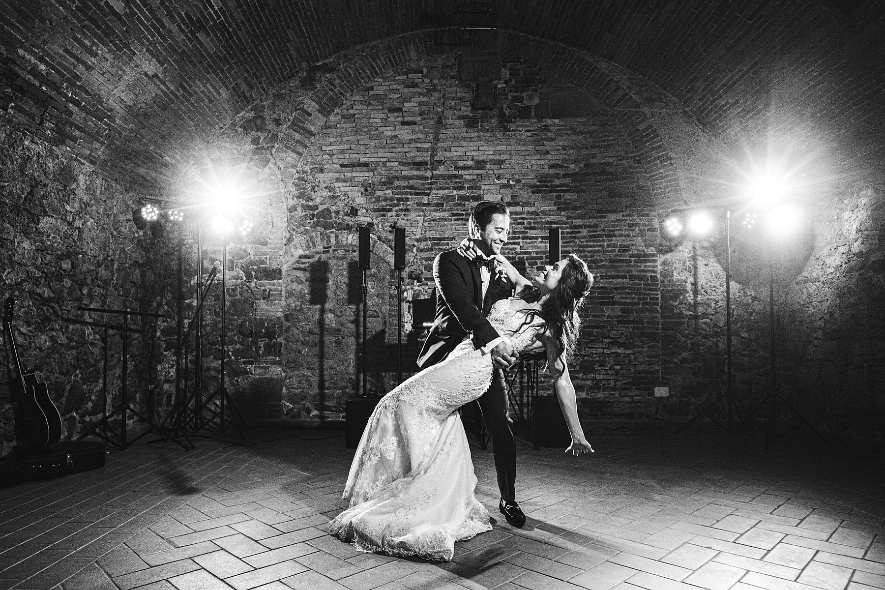 Beautiful bride and groom first dance at historic estate of Villa La Selva in the Tuscany countryside