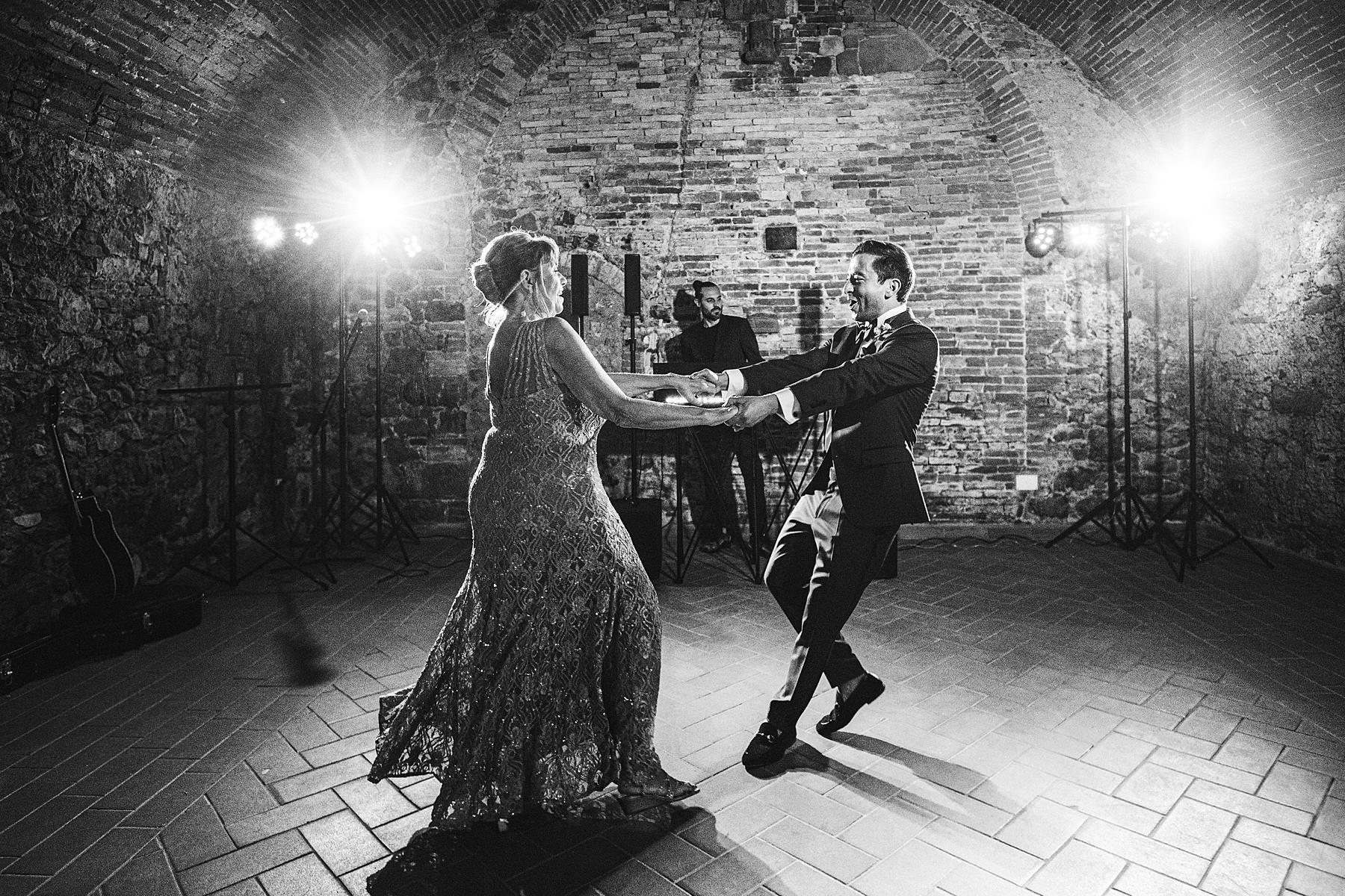 Groom and mother dance at Villa La Selva Wine Resort destination wedding